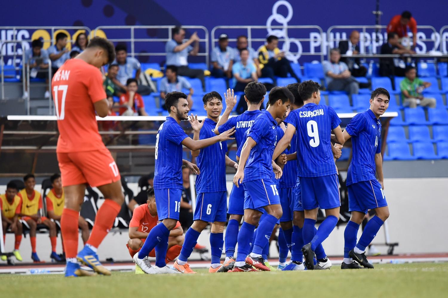 Thai players celebrate after scoring a goal against Singapore on Sunday.