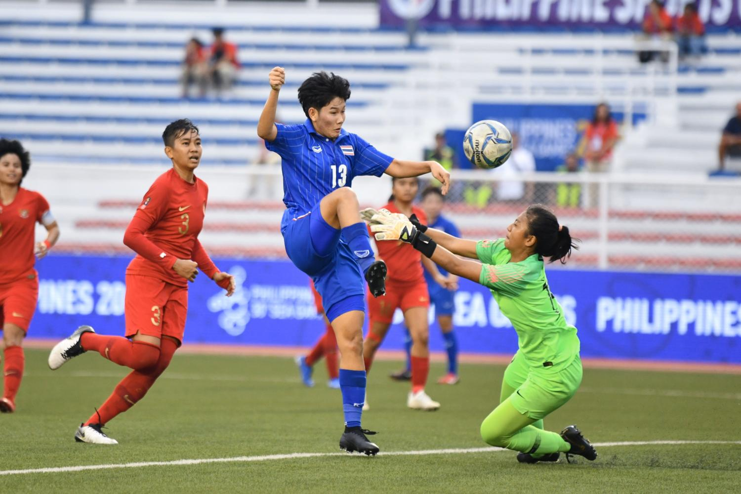 Thailand's Kanyanat Chetthabutr, No.13, scores against Indonesia.