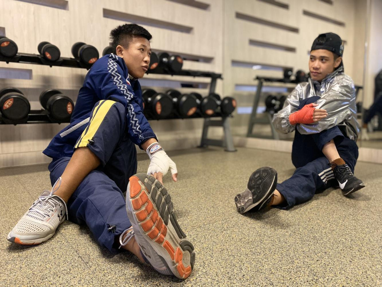 Boxers Sudaporn Seesondee, left, and Jutamas Jitpong train on Tuesday.