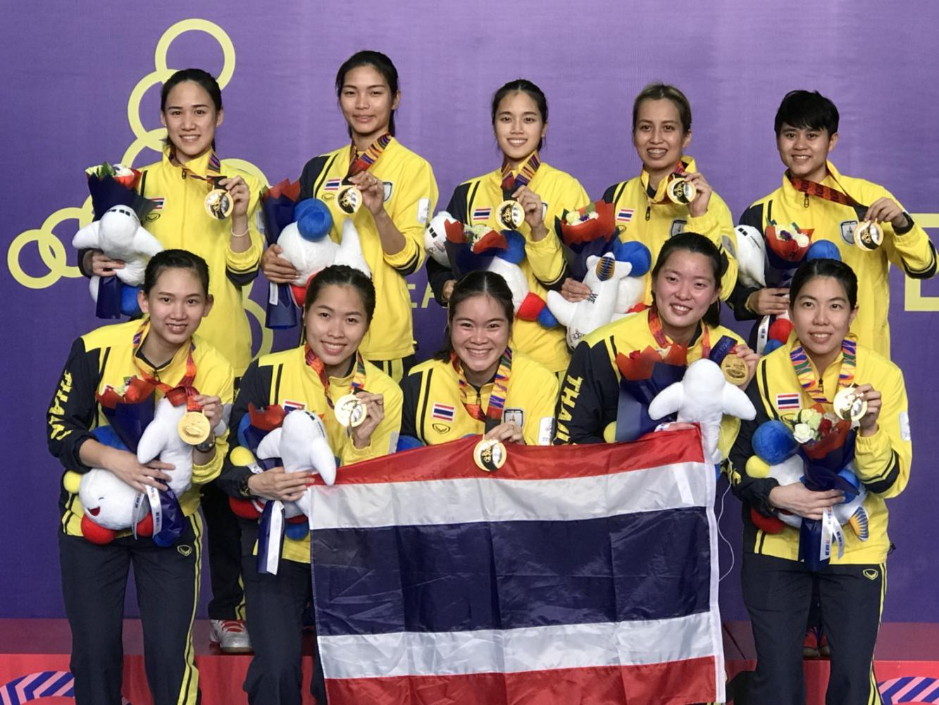 Members of the Thai women's badminton team pose with their gold medals at the SEA Games in Manila on Tuesday. PR