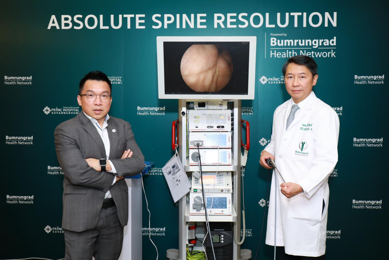 Dr Suthon (left) and Dr Verapan with some of the imaging equipment used at the Bumrungrad Spine Institute.
