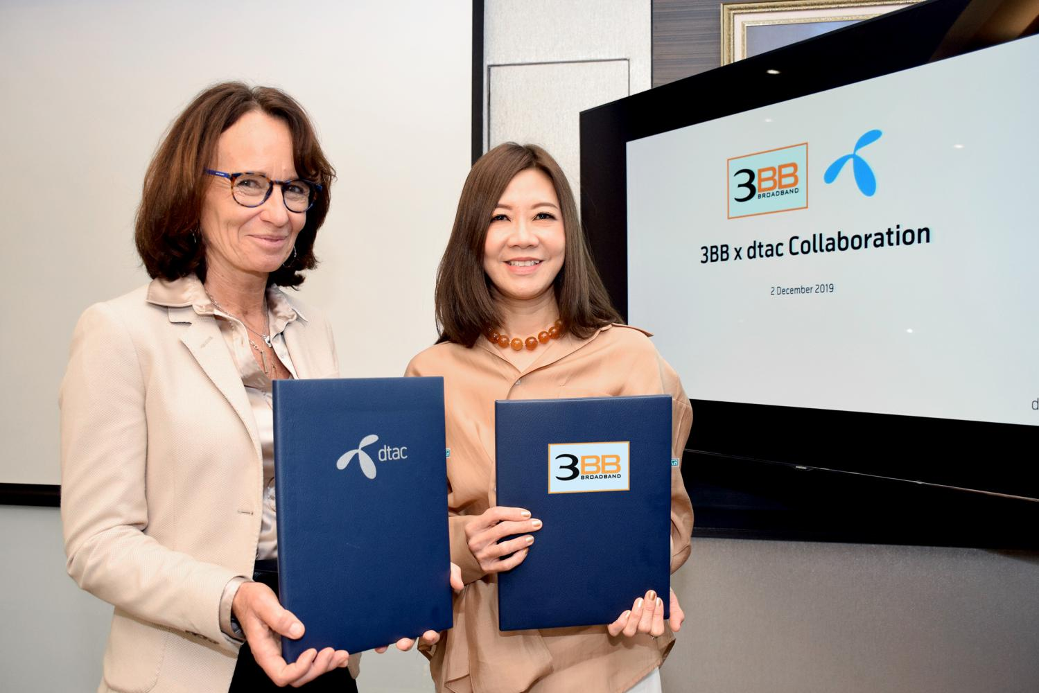 Alexandra Reich, chief executive of DTAC, left, and Saijai Kitsin, director of Triple T Broadband, promote the collaboration.
