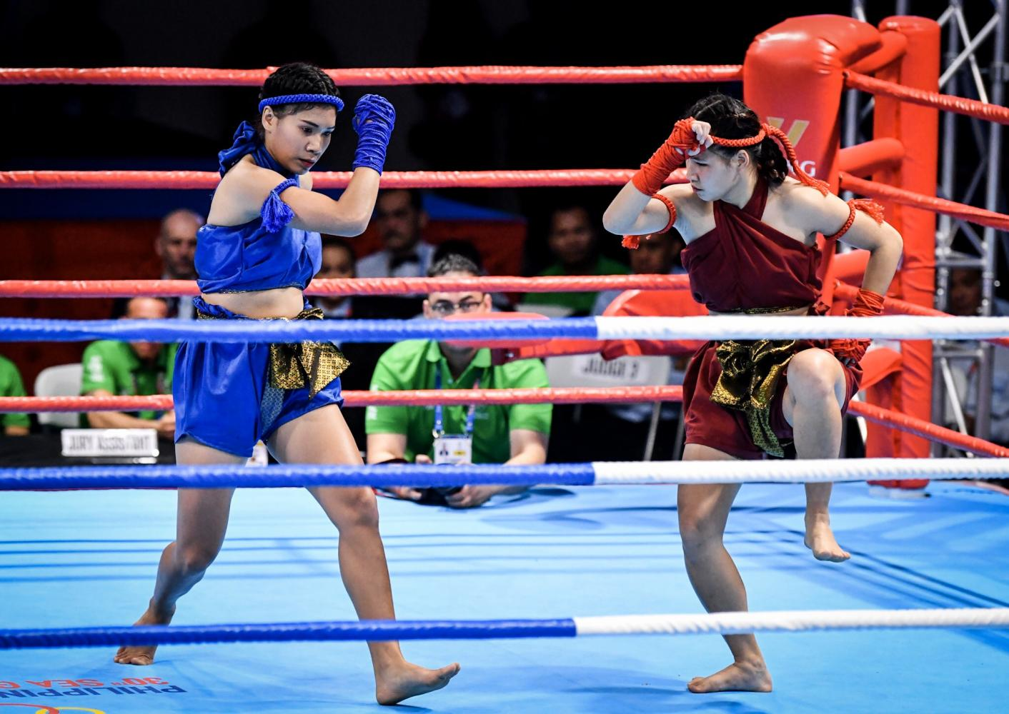 Thanawan Thongduang (right) and Ruchira Wongsriwo perform during the final of the waikru mai muaythai competition.