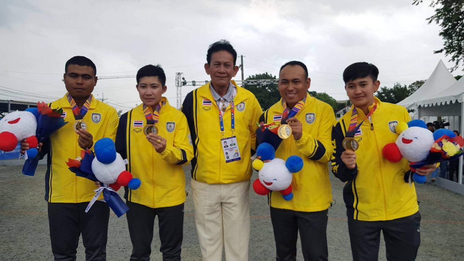 The petanque doubles teams with their gold medals.