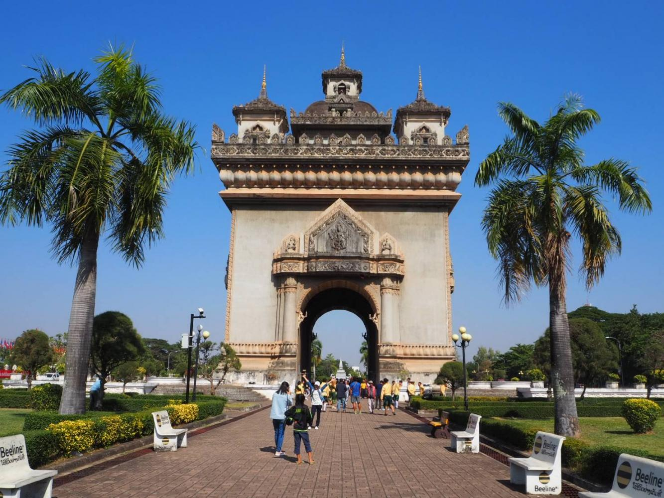Visitors take photos at the Patuxai (Victory Gate) in Vientiane. Laos is a potential originating market for well-heeled tourists.