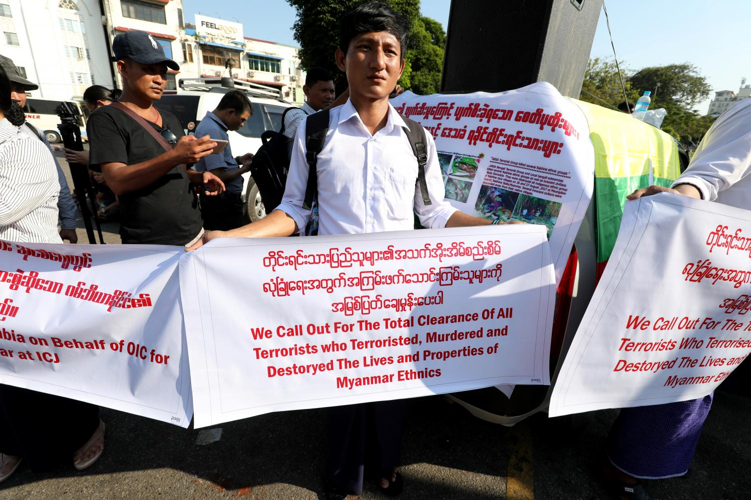 Left  Nationalists gather to protest in Yangon last month against The Gambia and the Organisation of Islamic Cooperation (OIC) for accusing Myanmar of committing genocide against the Rohingya minority in Rakhine state. Photos: Reuters