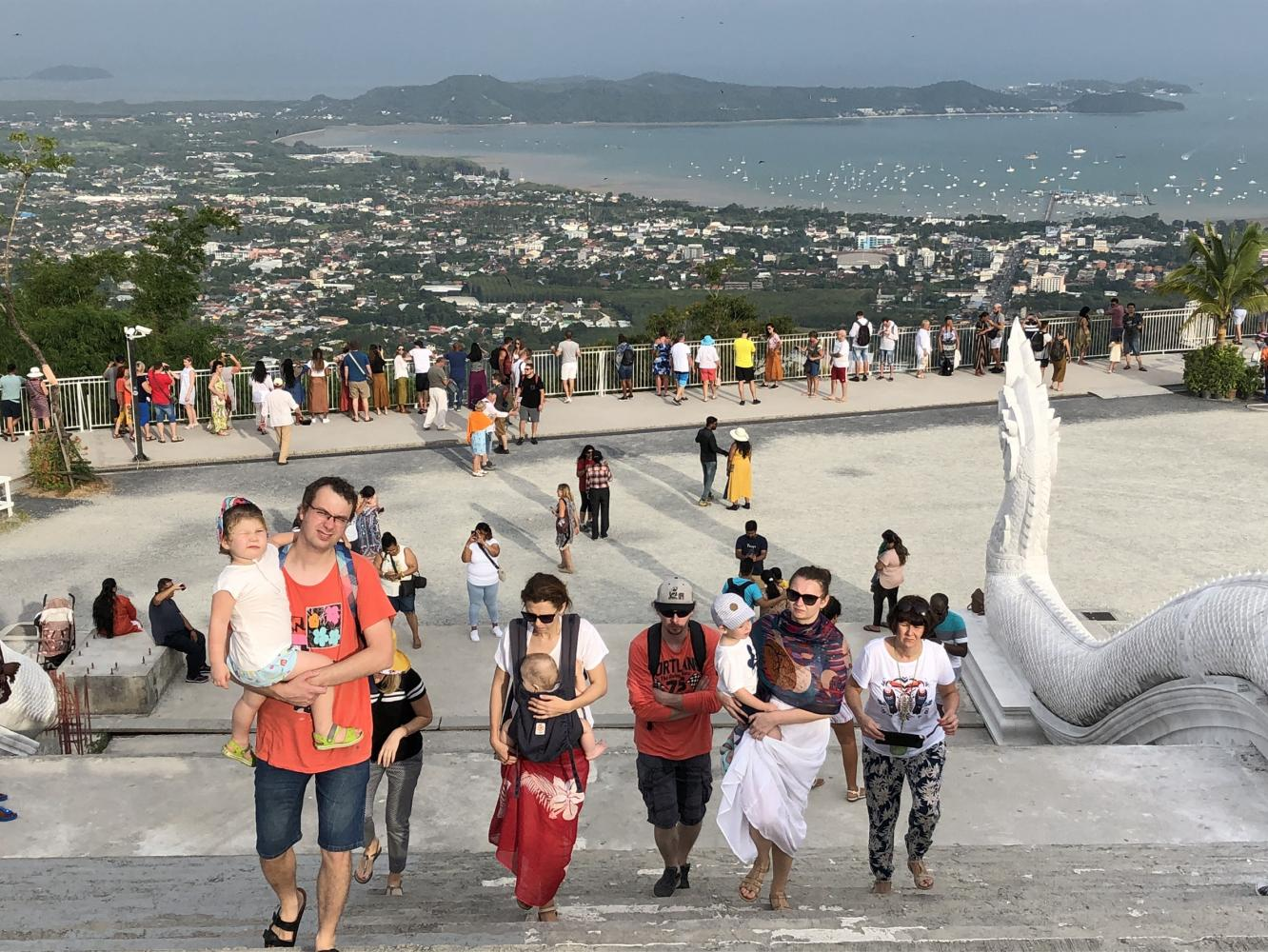 Tourists climb stairs to see Phuket's Big Buddha, a revered landmark on the southern island. The high season is starting later than usual this year.Sarot Meksophawannakul