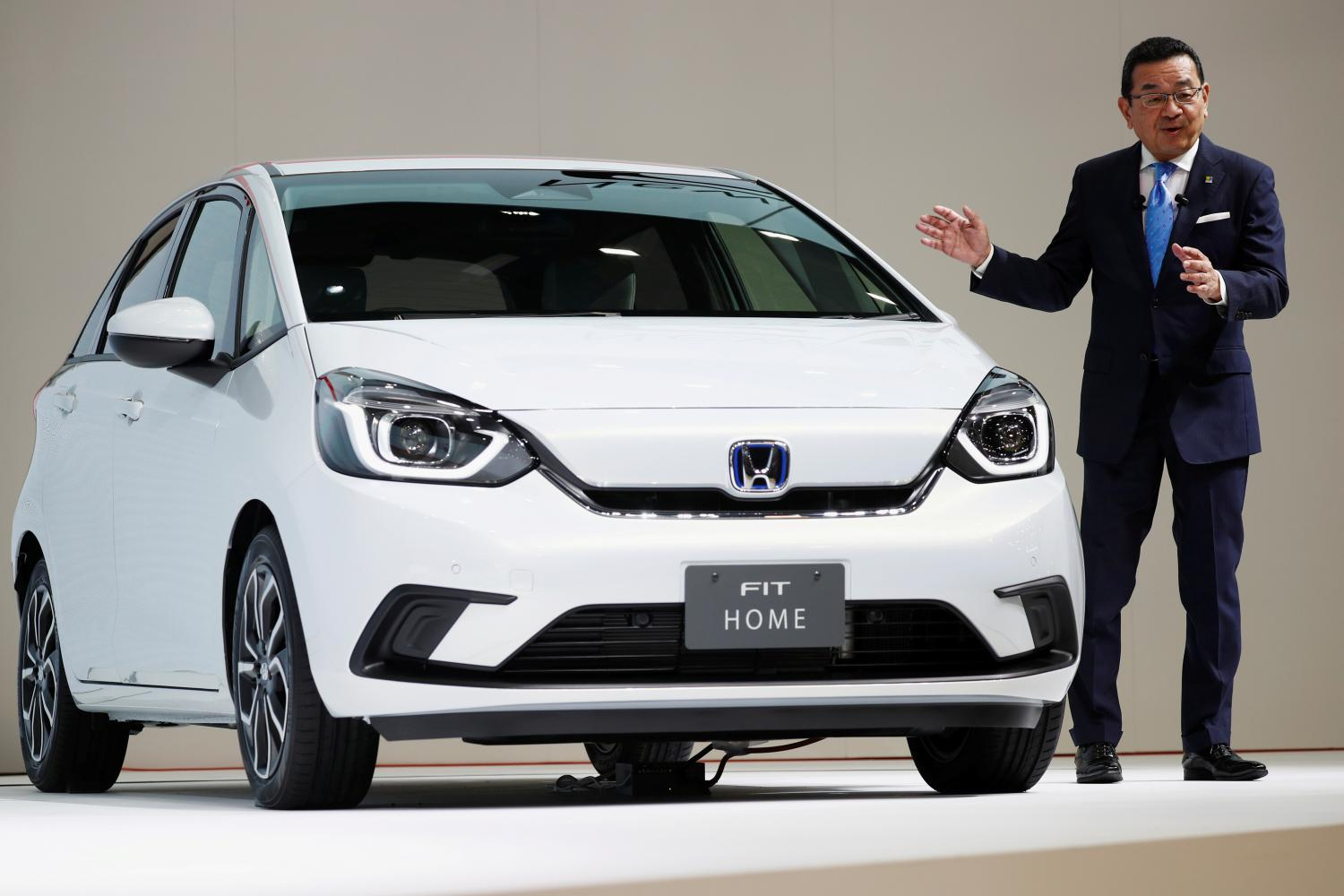 Takahiro Hachigo, president and CEO of Honda Motor Co, shows the new Honda Fit during the Tokyo Motor Show on Oc 23, 2019.(Reuters photo)