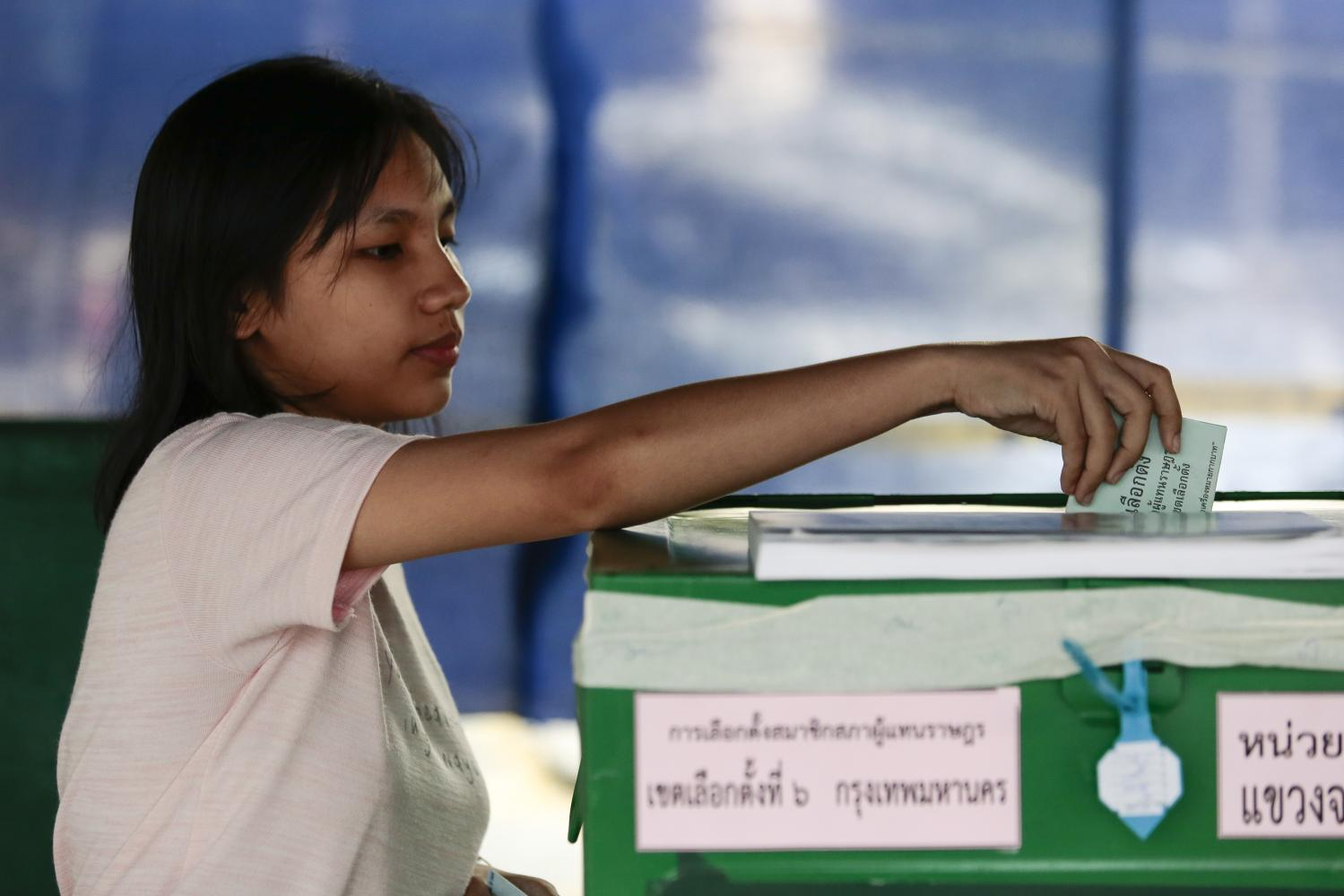 A woman casts her ballot at a polling station in Chatuchak district during the March general election. S&P Global Ratings raised its outlook on Thailand's sovereign credit rating to positive from stable, citing greater political stability. Patipat Janthong