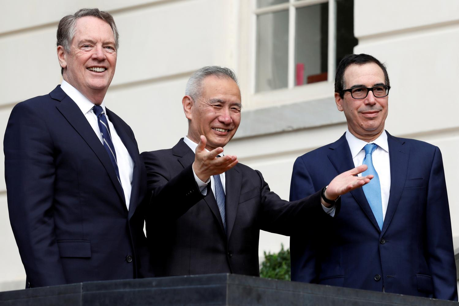 Chinese Vice Premier Liu He gestures to reporters as US Trade Representative Robert Lighthizer (left) and Treasury Secretary Steve Mnuchin look on during a break in trade negotiations in Washington in October. (Reuters file photo)
