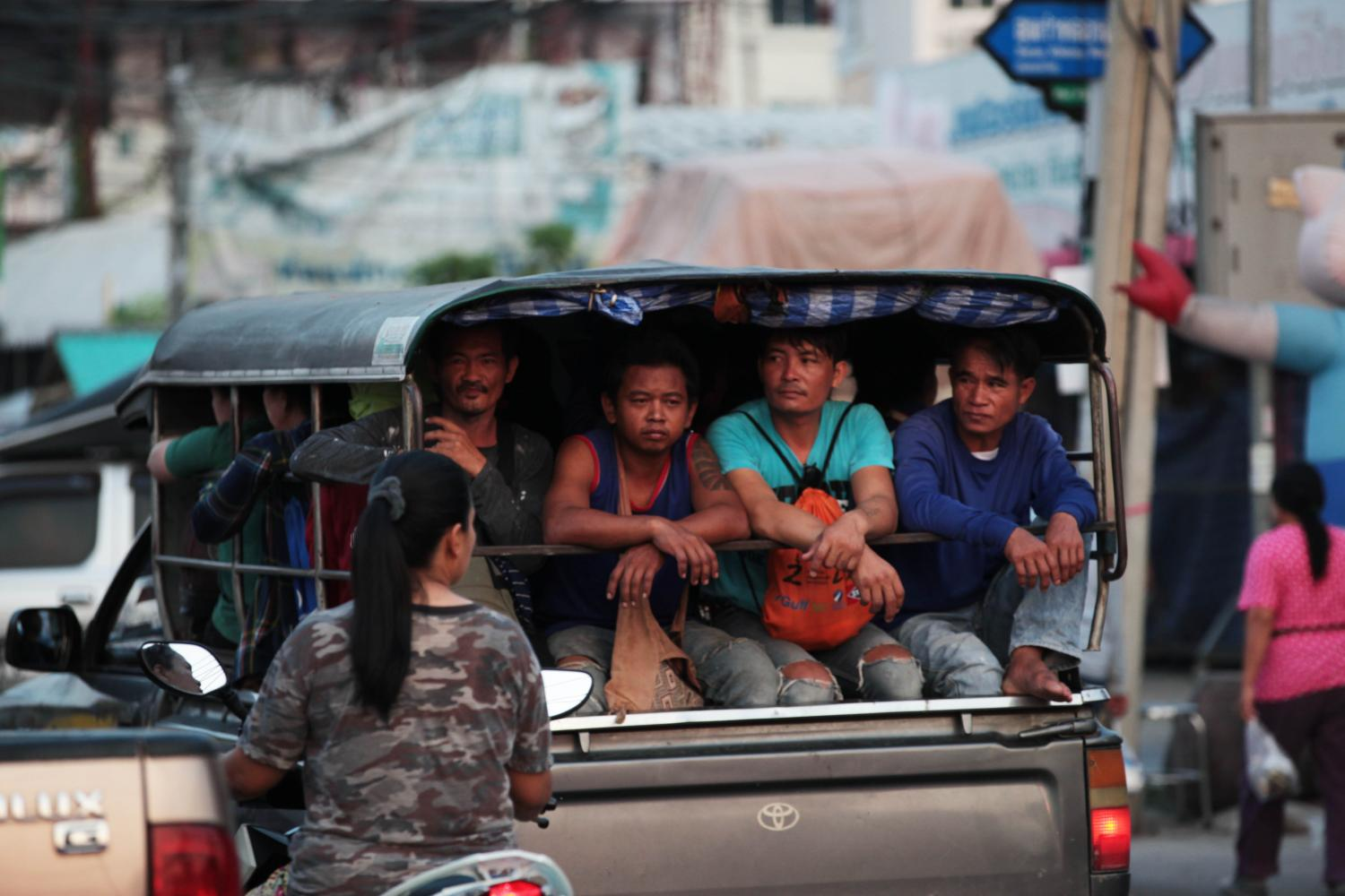 Workers in a pickup truck head off to work along Surao Khlong 1 Road, better known as Kip Mu Road, in Min Buri district of Bangkok.Post Today