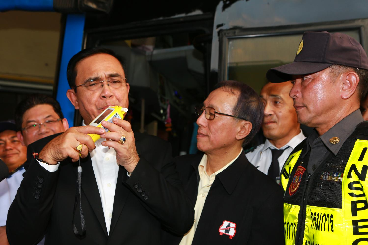 Prime Minister Prayut Chan-o-cha blows into a breathalyser as he kicks off a road safety campaign at Bangkok's Mor Chit bus terminal on Thursday. (Photo by Somchai Poomlard)