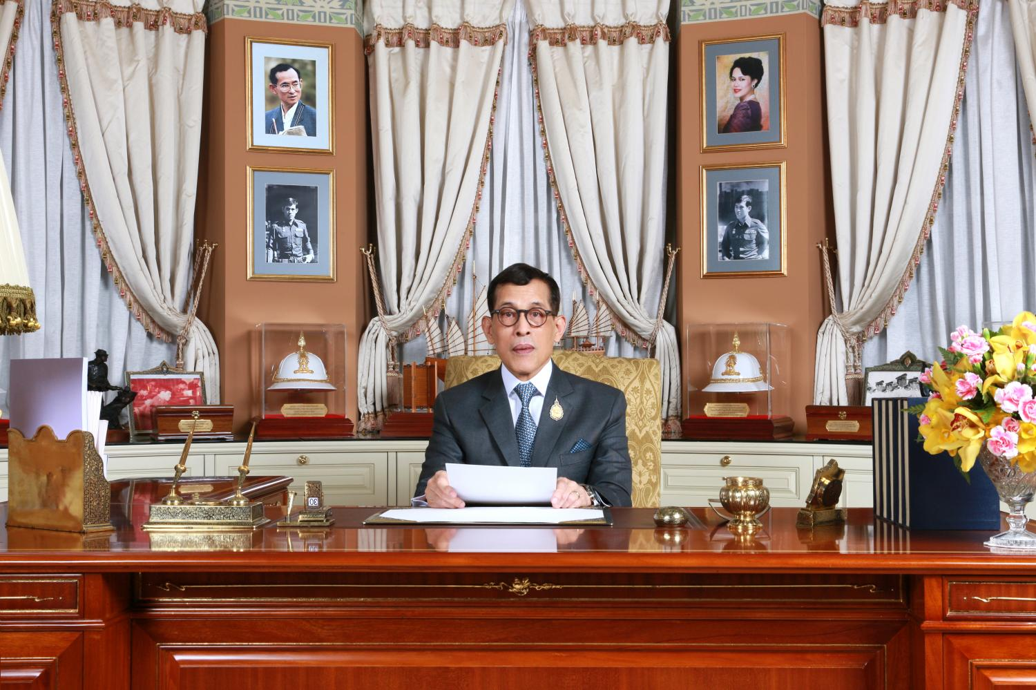 His Majesty the King expresses his best wishes for Thais in a nationwide broadcast Tuesday night.Photos by Royal Household Bureau