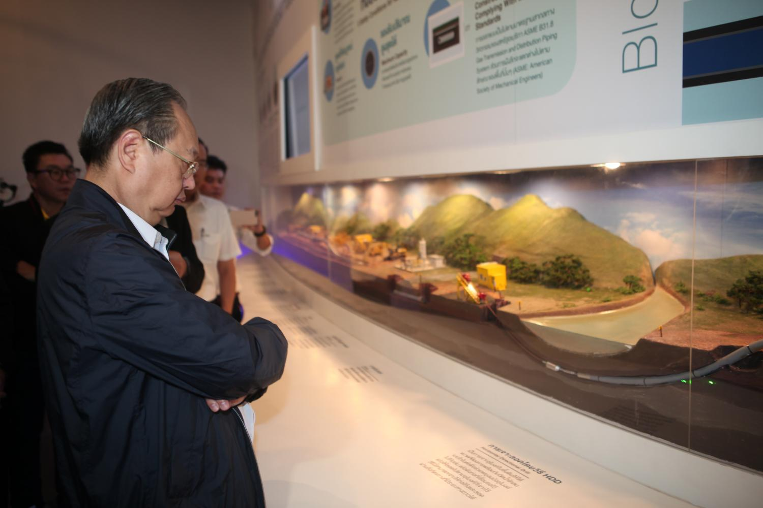 Mr Sontirat looks at a model of the PTT natural gas pipeline, one of the large projects to serve gas-fired power plants.