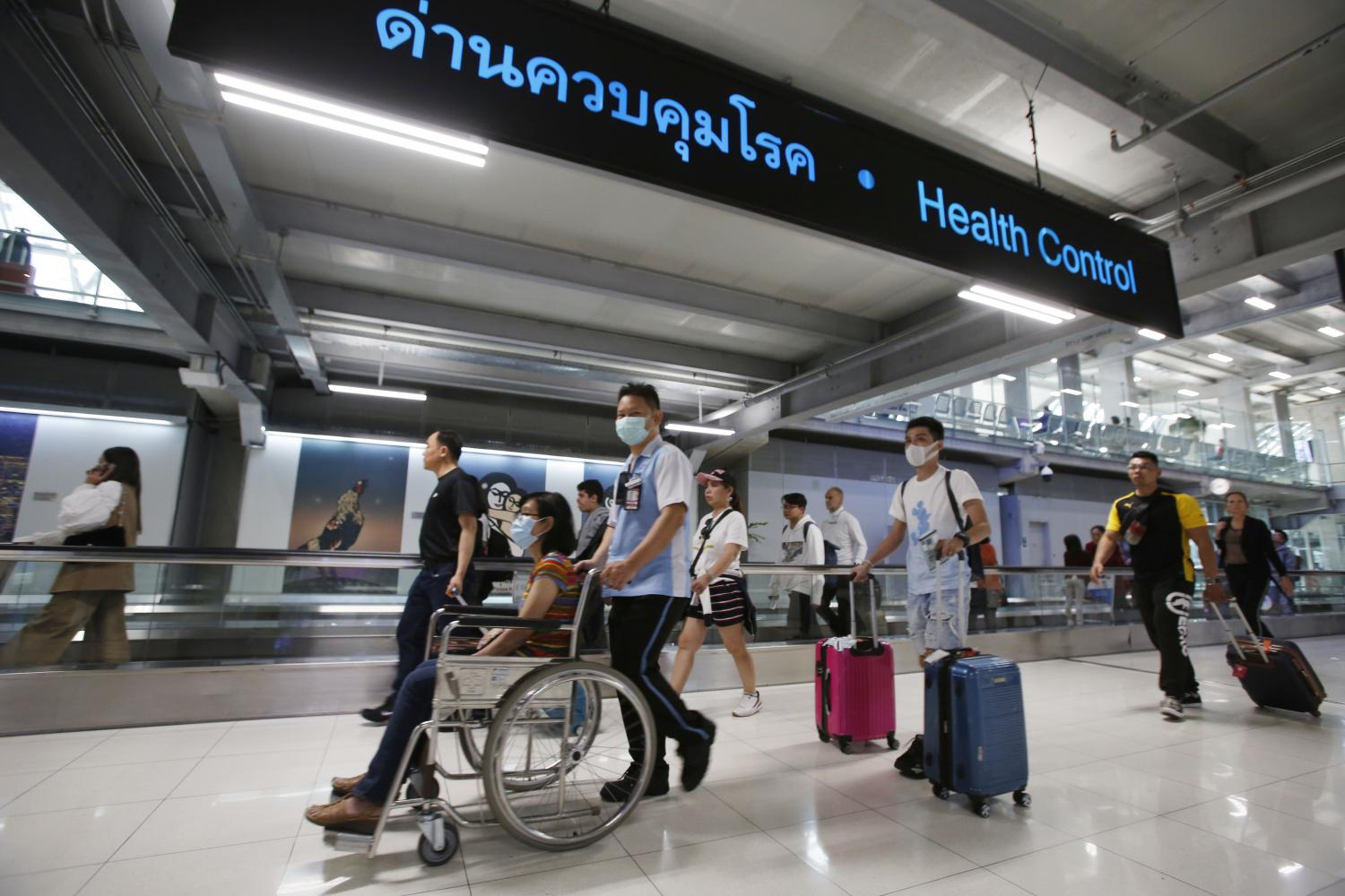 Suvarnabhumi Airport is adopting stricter health measures to monitor travellers arriving from China where a mysterious viral pneumonia has broken out. (Photo by   Pornprom Satrabhaya)