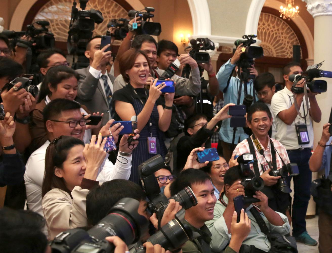 Reporters and photographers at Government House. Media and technology experts warn the media must adjust to catch up with fast-changing digital technology.Chanat Katanyu