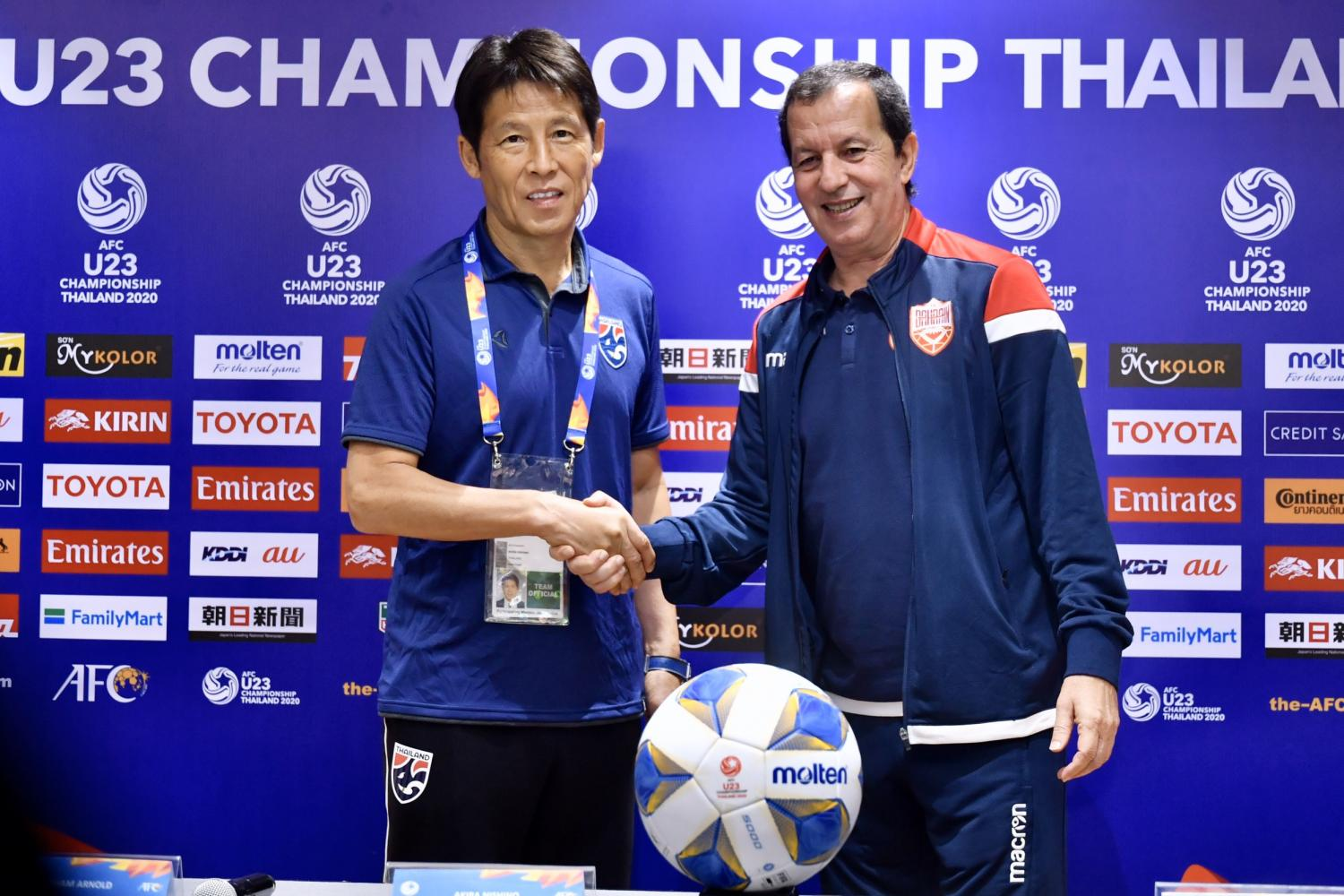 Thailand coach Akira Nishino (left) and Bahrain boss Samir Chammam shake hands at a press conference on Tuesday.