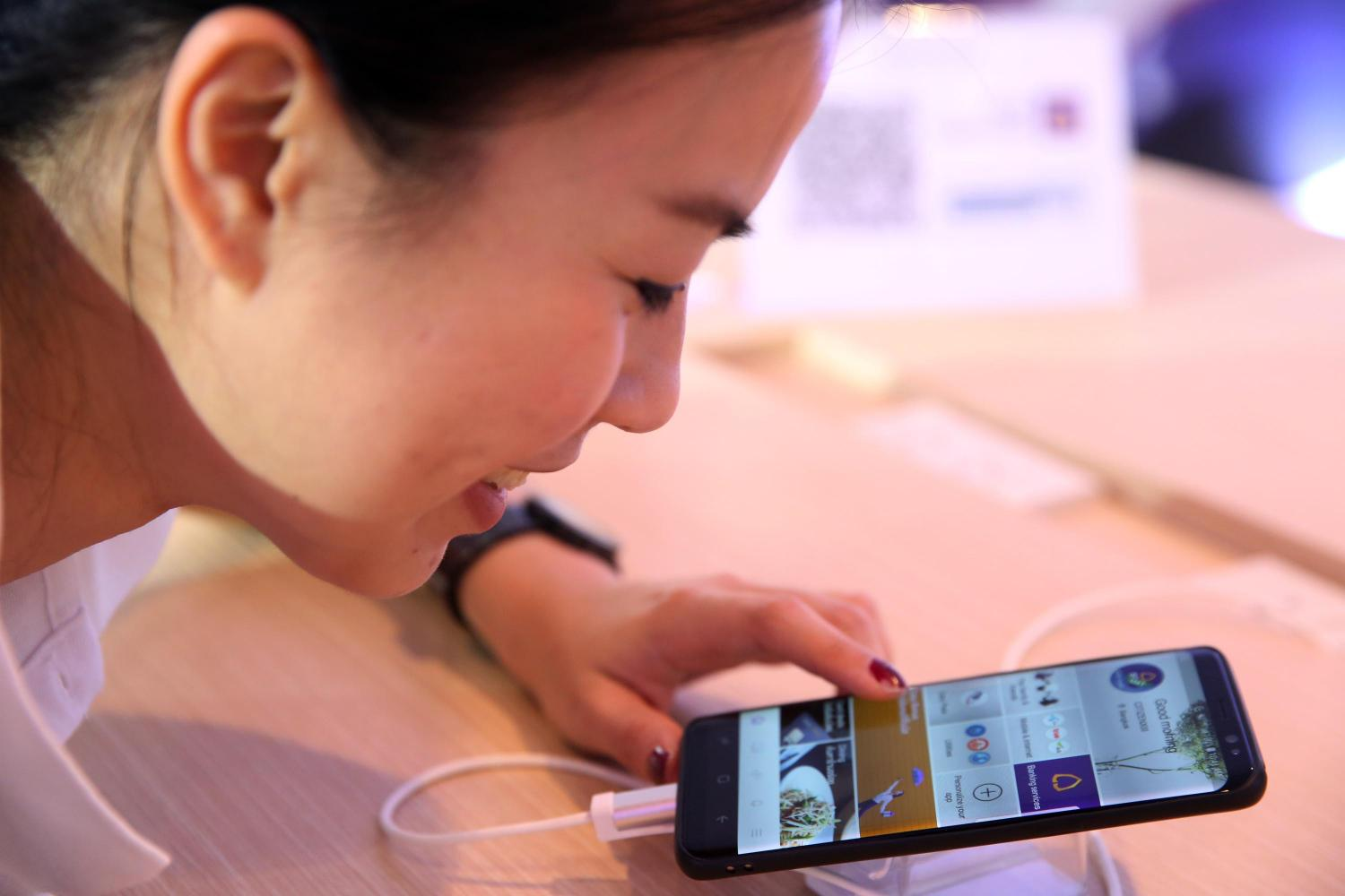 A customer browses SCB Easy, a mobile banking app.
