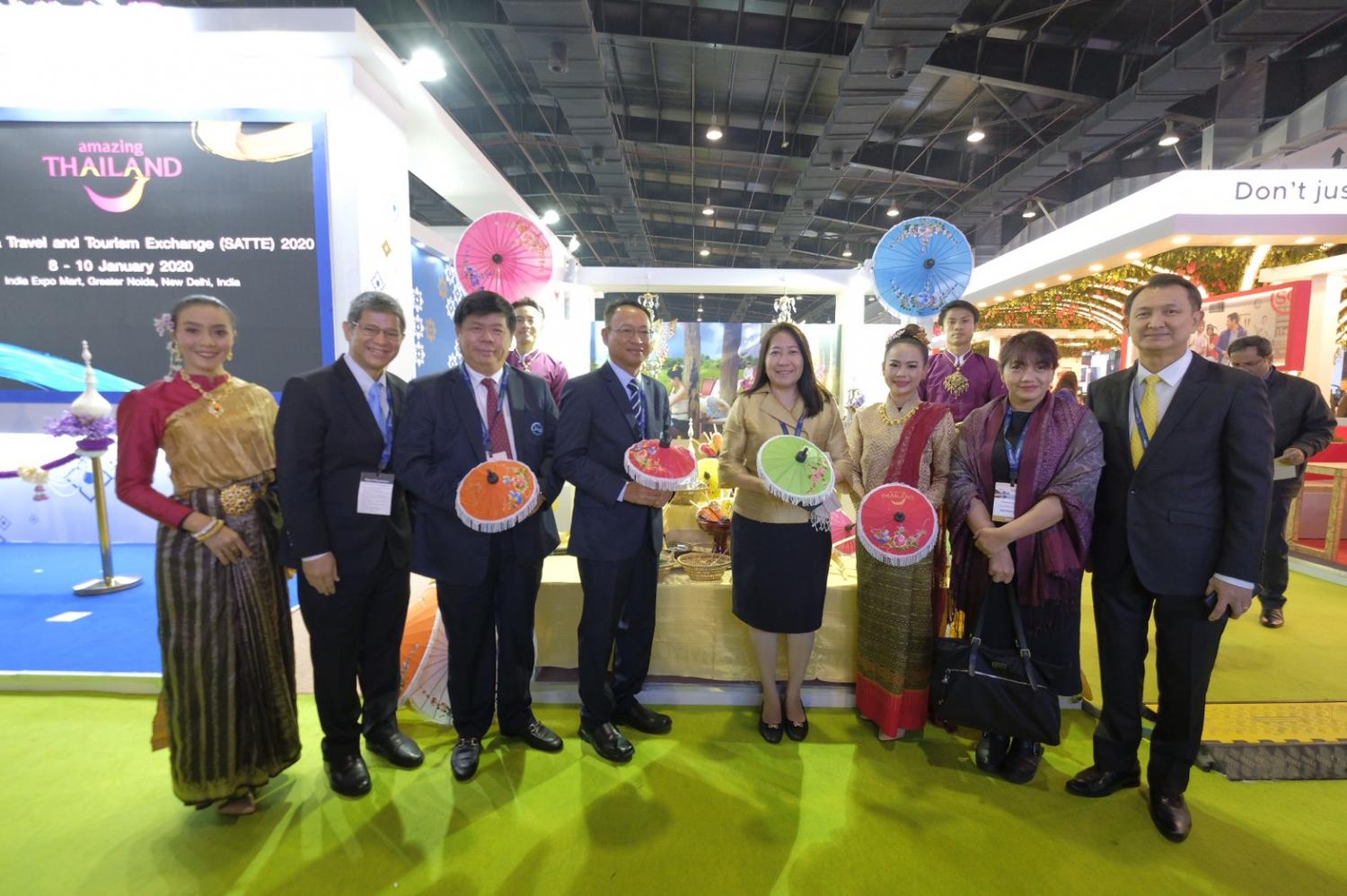 Mr Chattan (second left) and Mr Klissada (far right) at the opening ceremony for the Thailand pavilion at the South Asia Travel and Tourism Exchange in India.
