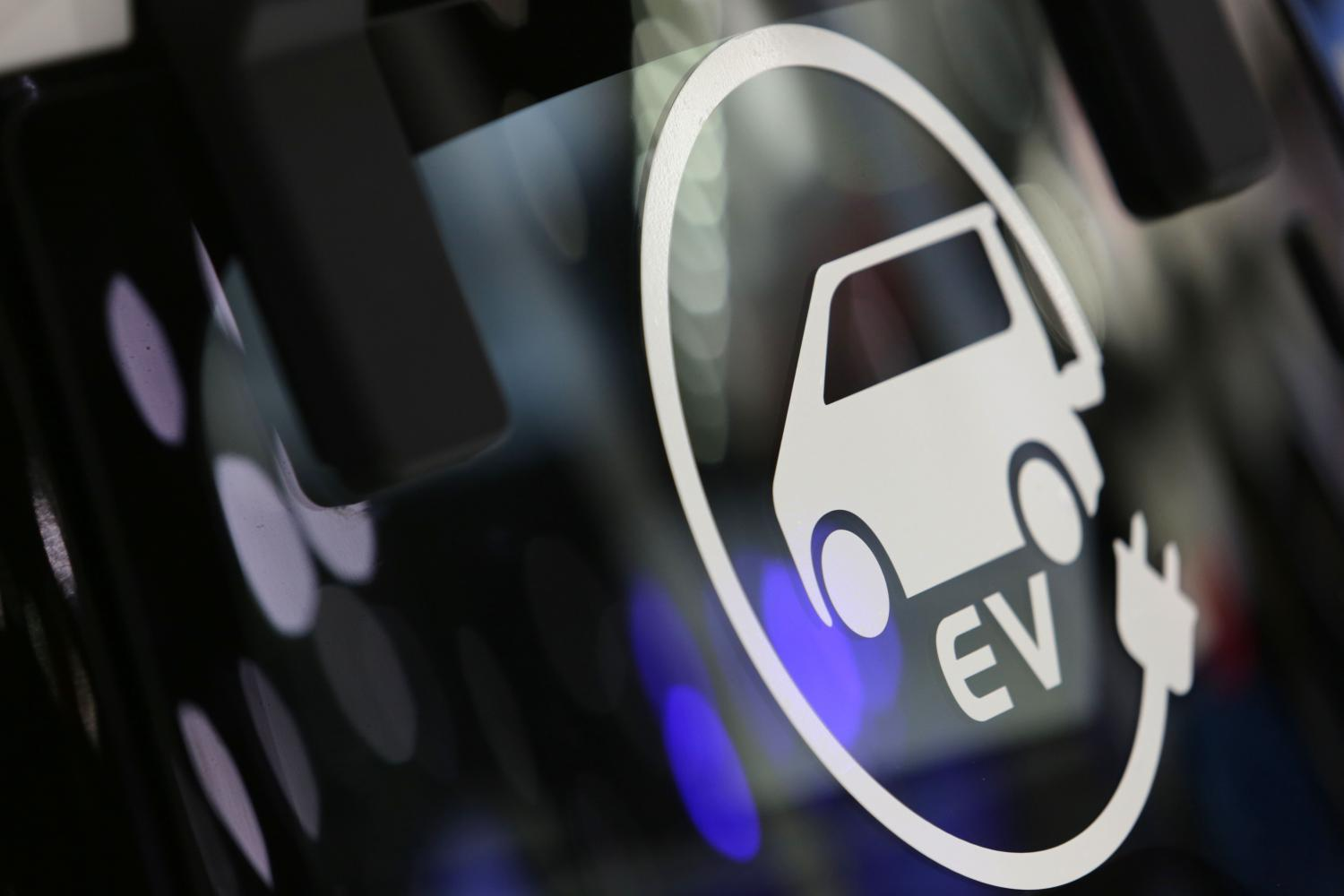 An EV logo at the 35th Thailand International Motor Expo. The government is putting in effort to make Thailand an EV hub for the region.