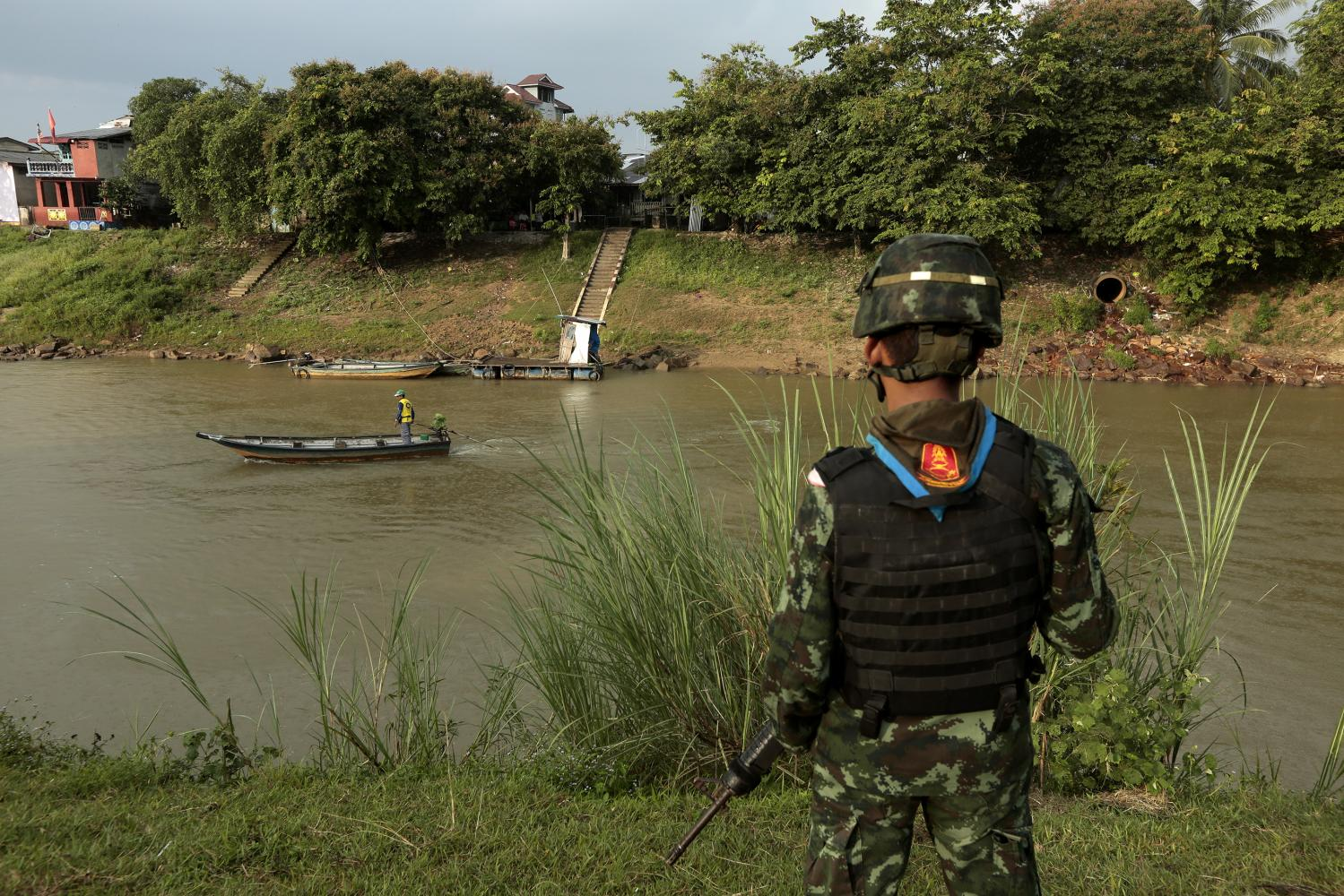 ON PATROL: Troops are deployed along the Kolok River in Narathiwat's Sungai Kolok district. The river is a natural borderline between Thailand and Malaysia.
