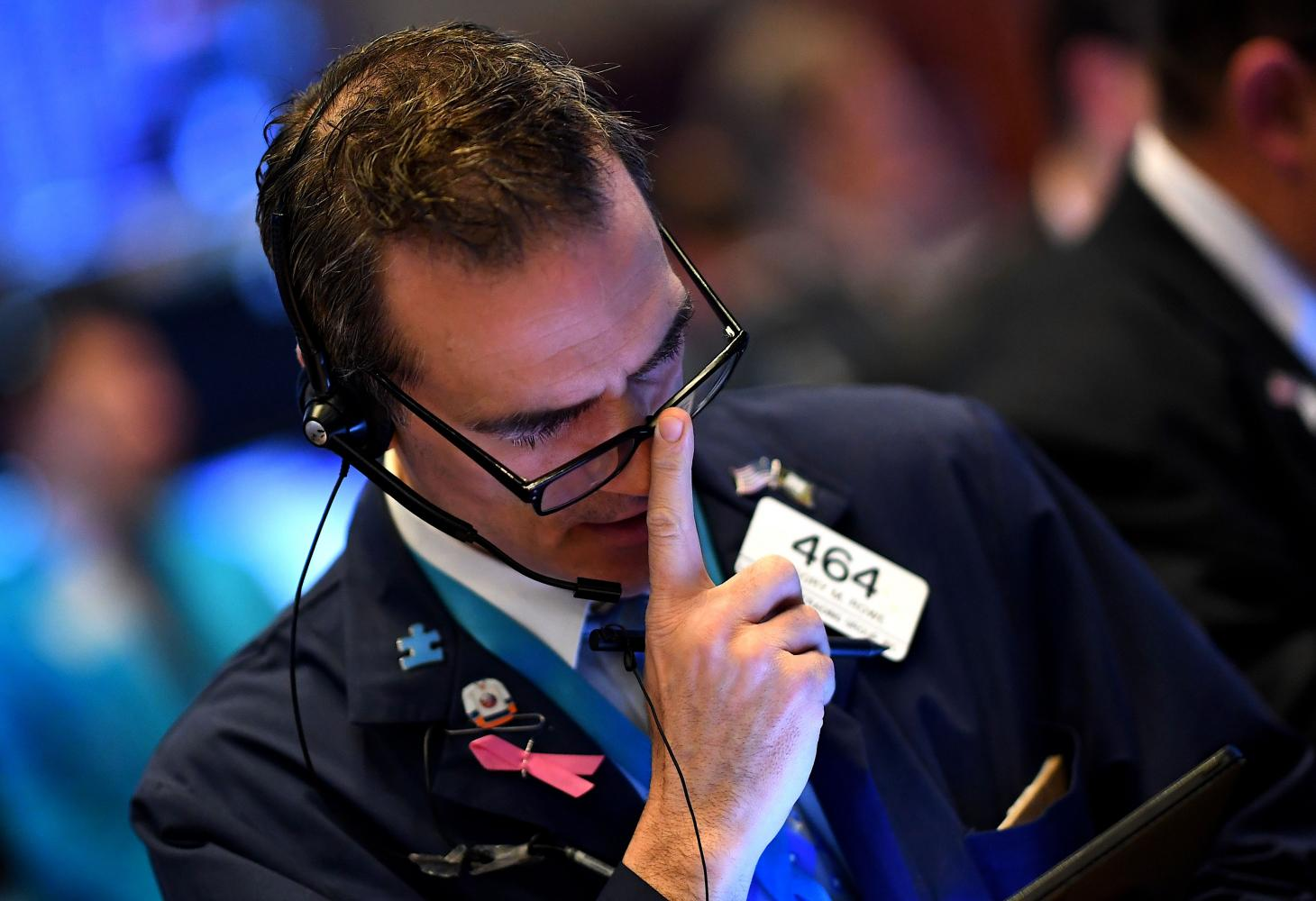 Traders work during the opening bell at the New York Stock Exchange on Monday on Wall Street in New York City. AFP