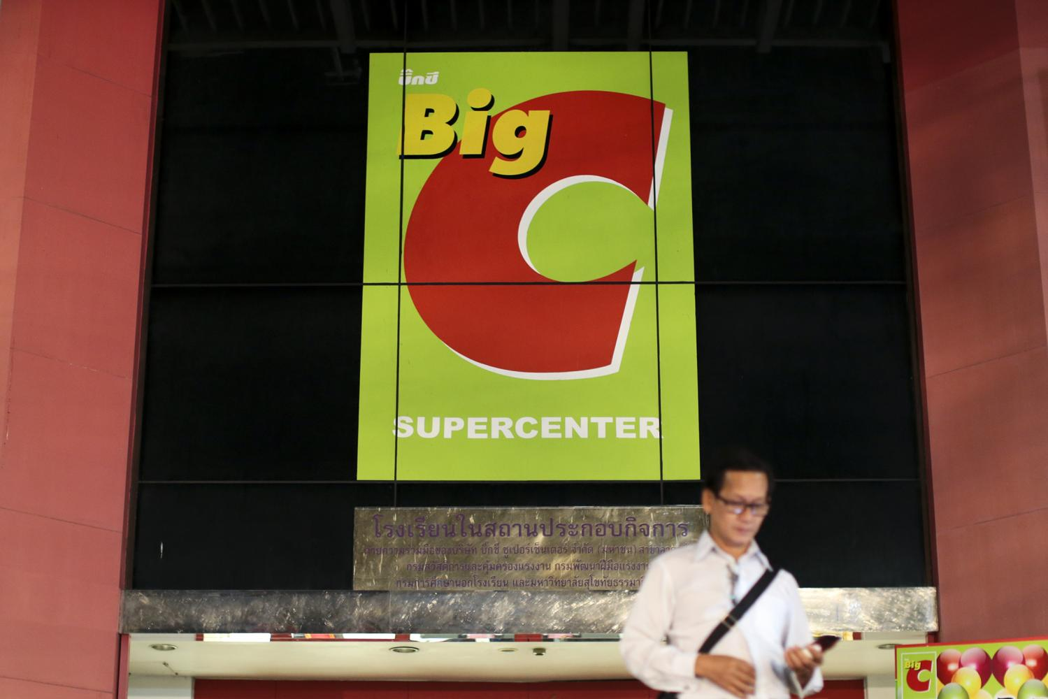 A shopper walks past a Big C Supercenter in Bangkok. The company operates 1,231 stores across the country. (Photo by Patipat Janthong)