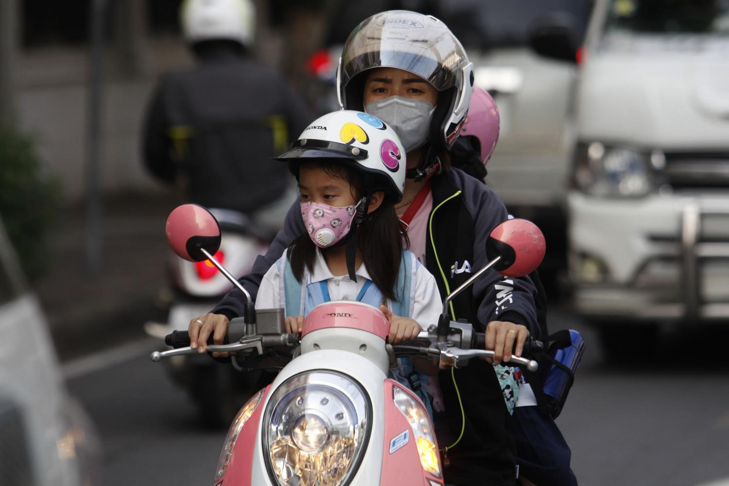 Masks have become another important protector besides crash helmets during rides along roads in Samut Prakan's Muang district, which has recorded very high ultra-fine dust PM2.5 levels.Wichan Charoenkiatpakul