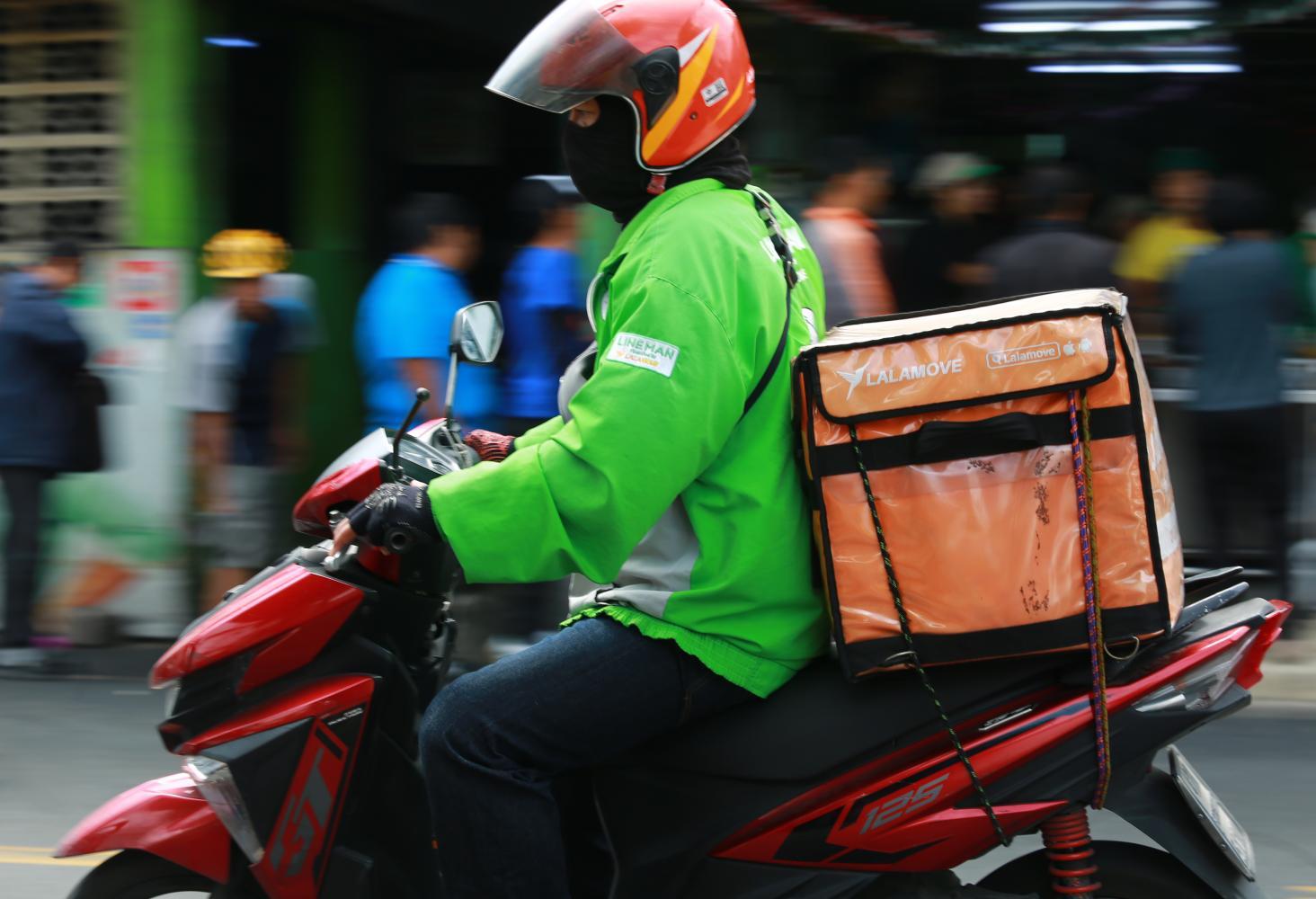 A Line Man driver makes his rounds in Bangkok. Somchai Poomlard
