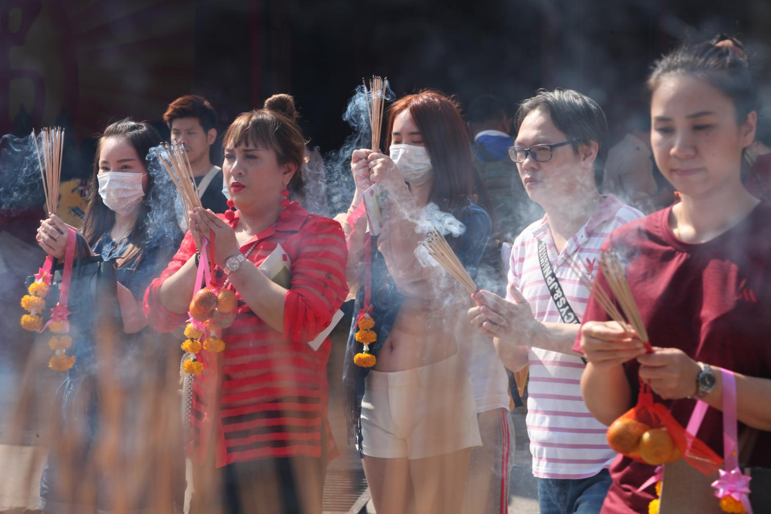 Passive smoking: Wat Mangkon Kamalawat, a famous Chinese Buddhist temple in Yaowarat is trying to improve local air quality by reducing the number of incense burners and only allowing burning activities to occur in outside areas.