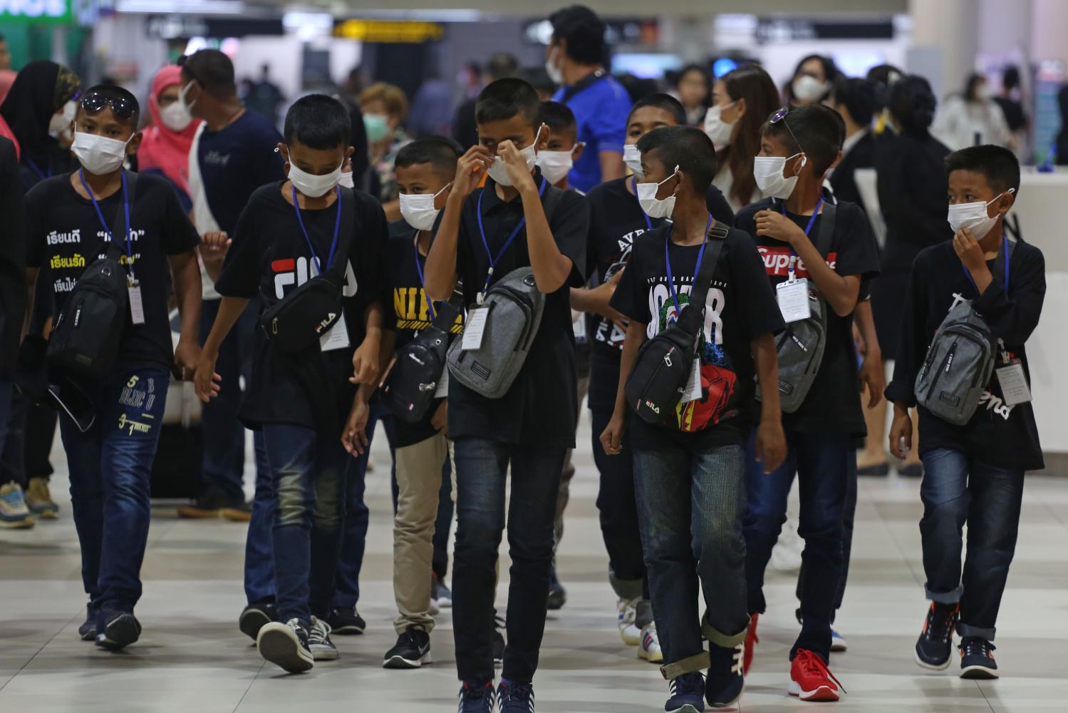 Children wear face masks at Don Mueang airport to protect themselves from the coronavirus outbreak. (Photo by Varuth Hirunyatheb)