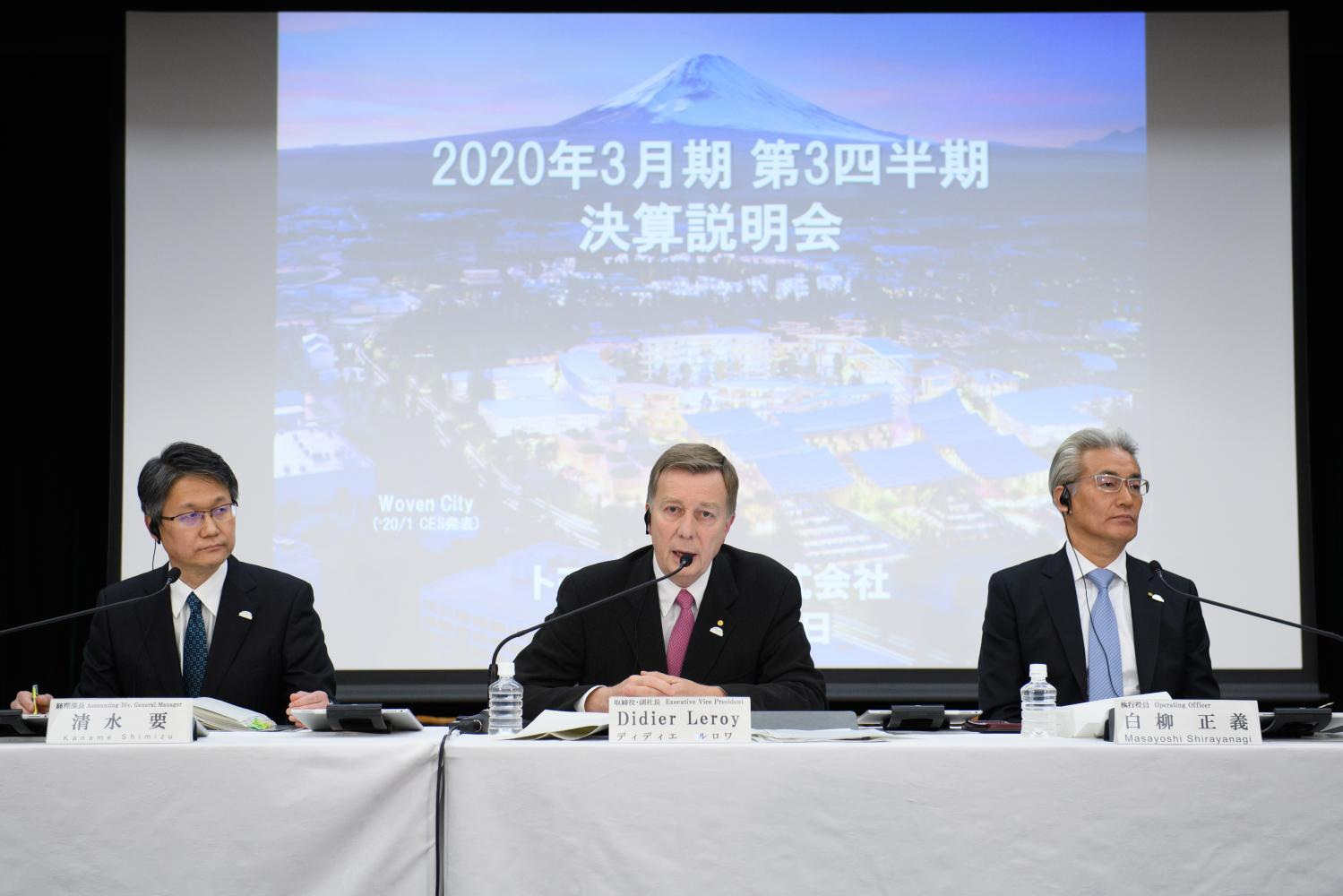 Didier Leroy, executive vice president of Toyota Motor Corp, centre, speaks as Masayoshi Shirayanagi, operating officer, right, and Kaname Shimizu, general manager of the accounting division, listen during a news conference in Tokyo on Thursday.  (Bloomberg photo)