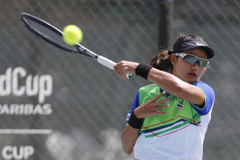 Tamachan Momkoonthod hits a return against Guam's Katrina Lai.