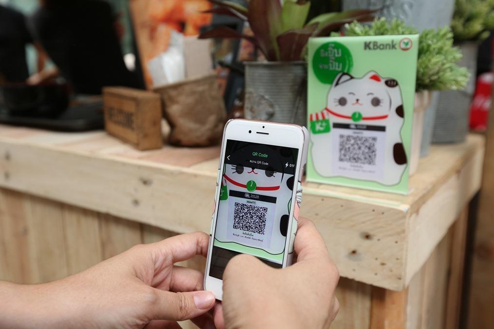 The K Plus app scans a barcode for payment. Banks have developed QR code payments that can be used in different countries.