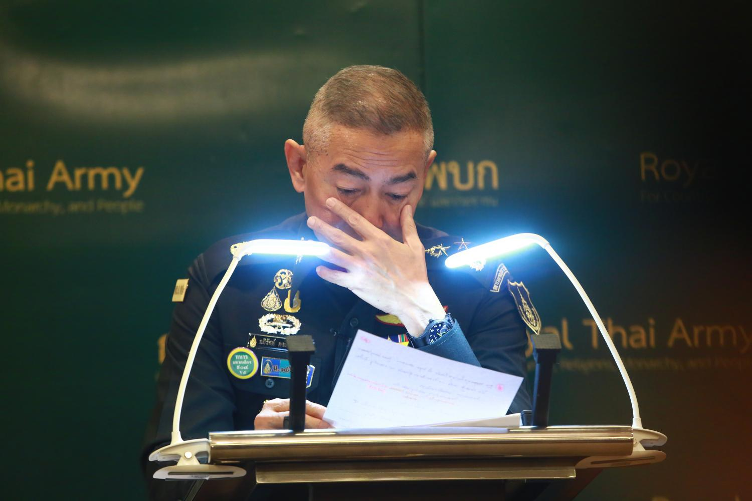 Army chief Gen Apirat Kongsompong weeps as he apologises for the mass shooting in Nakhon Ratchasima, during a media briefing at Royal Thai Army headquarters on Tuesday. Somchai Poomlard