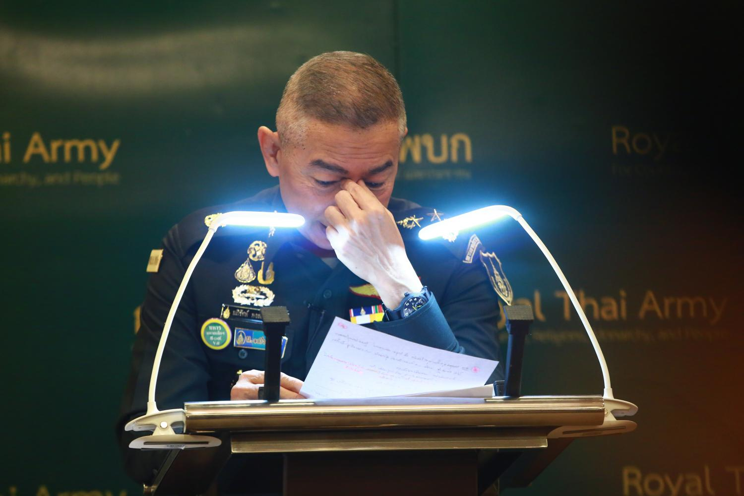 Army commander-in-chief Gen Apirat Kongsompong wipes away tears during a press conference on Tuesday while promising an overhaul of the army. (Photo by Somchai Poomlard)