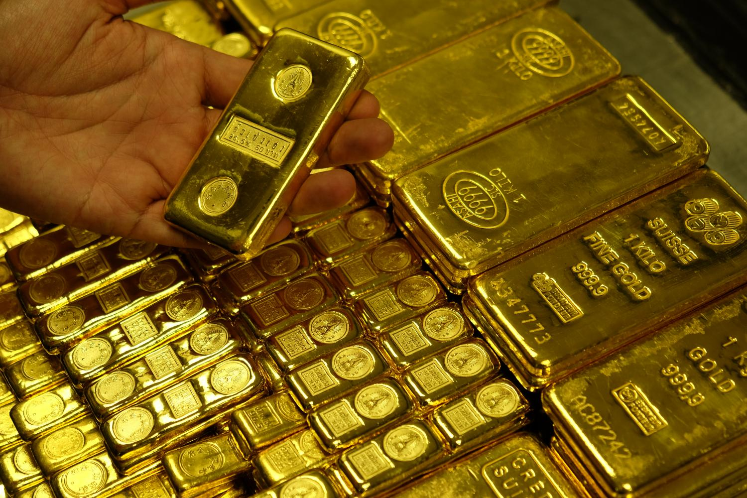Gold bars on display at a Hua Seng Heng shop. On top of the coronavirus epidemic, US politics is set to influence gold price movements.