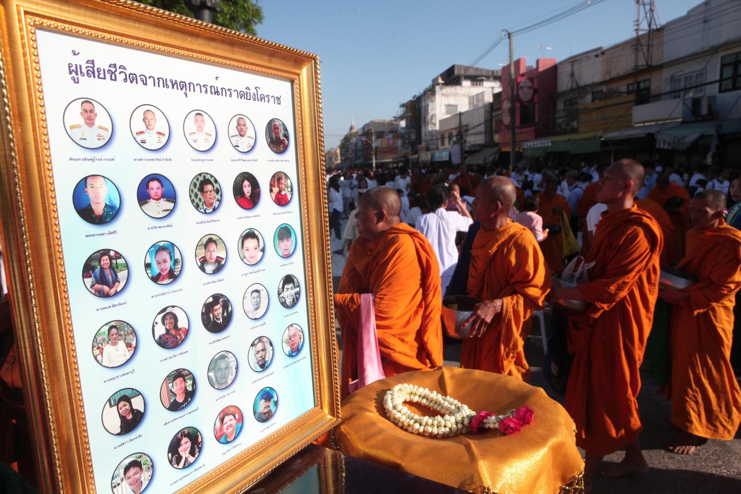 A merit-making ceremony is held in Nakhon Ratchasima on Saturday in honour of those killed at the mass shooting last weekend. (Photos by Apichart Jinakul)