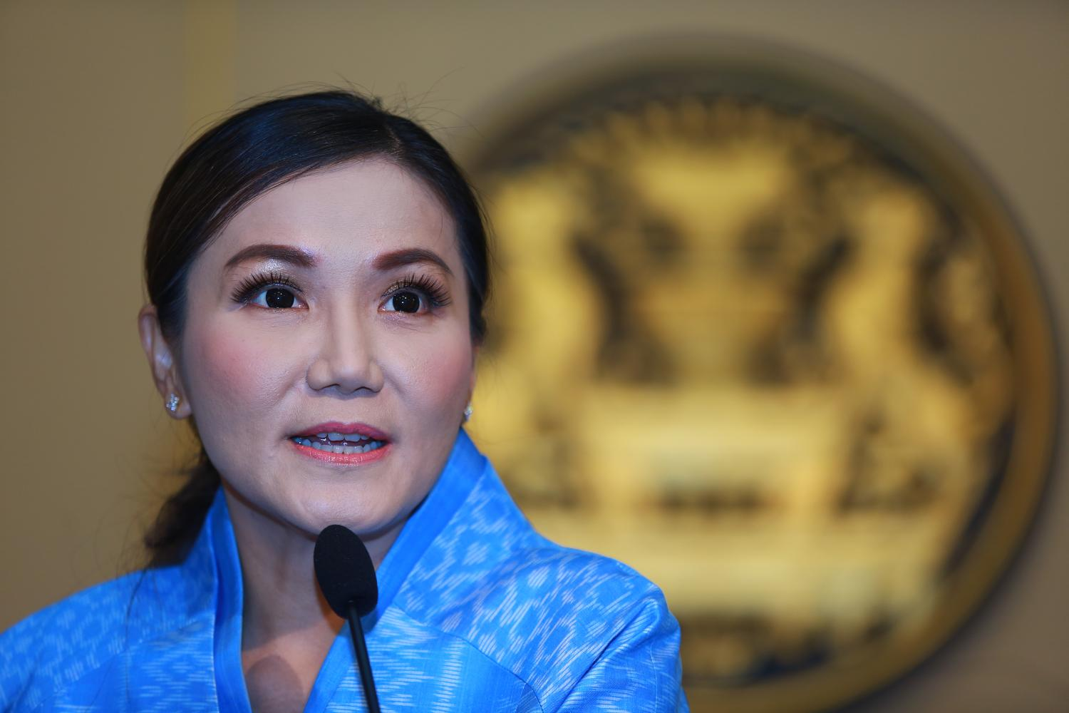 Government spokeswoman Narumon Pinyosinwat speaks to reporters at Government House after the weekly cabinet meeting on Tuesday.Somchai Poomlard