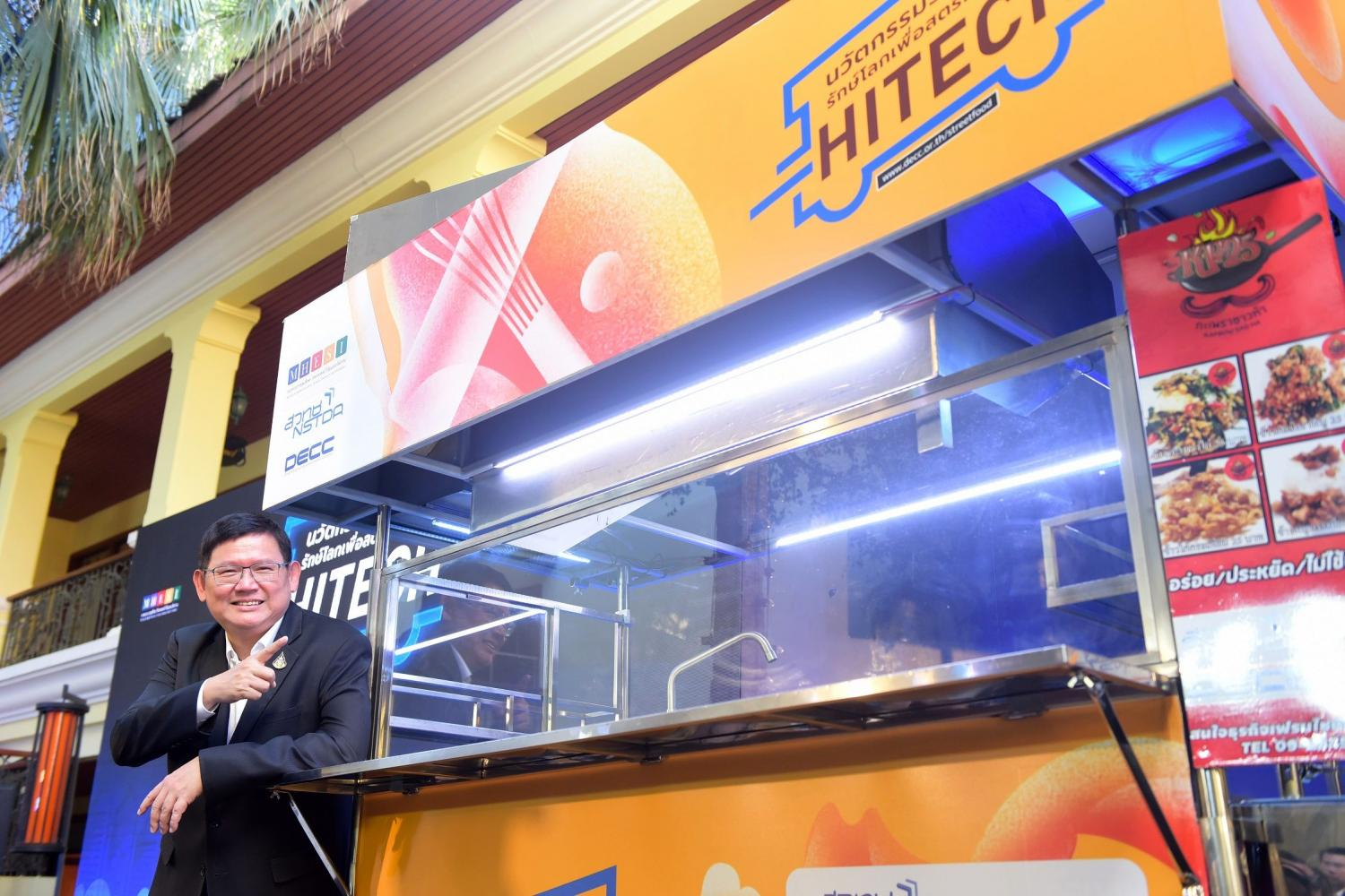 Minister of Higher Education, Science, Research and Innovation Suvit Maesincee demonstrates an environmentally friendly smart food cart developed by Thai inventors. National Science and Technology Development Agency