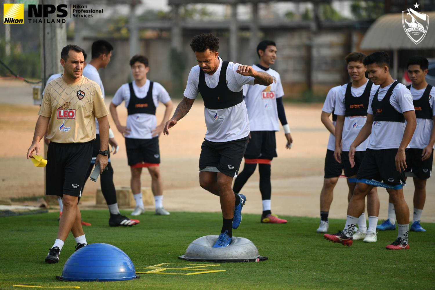 Chiang Rai United's Bill Rosimar, centre, takes part in a training session on Monday.