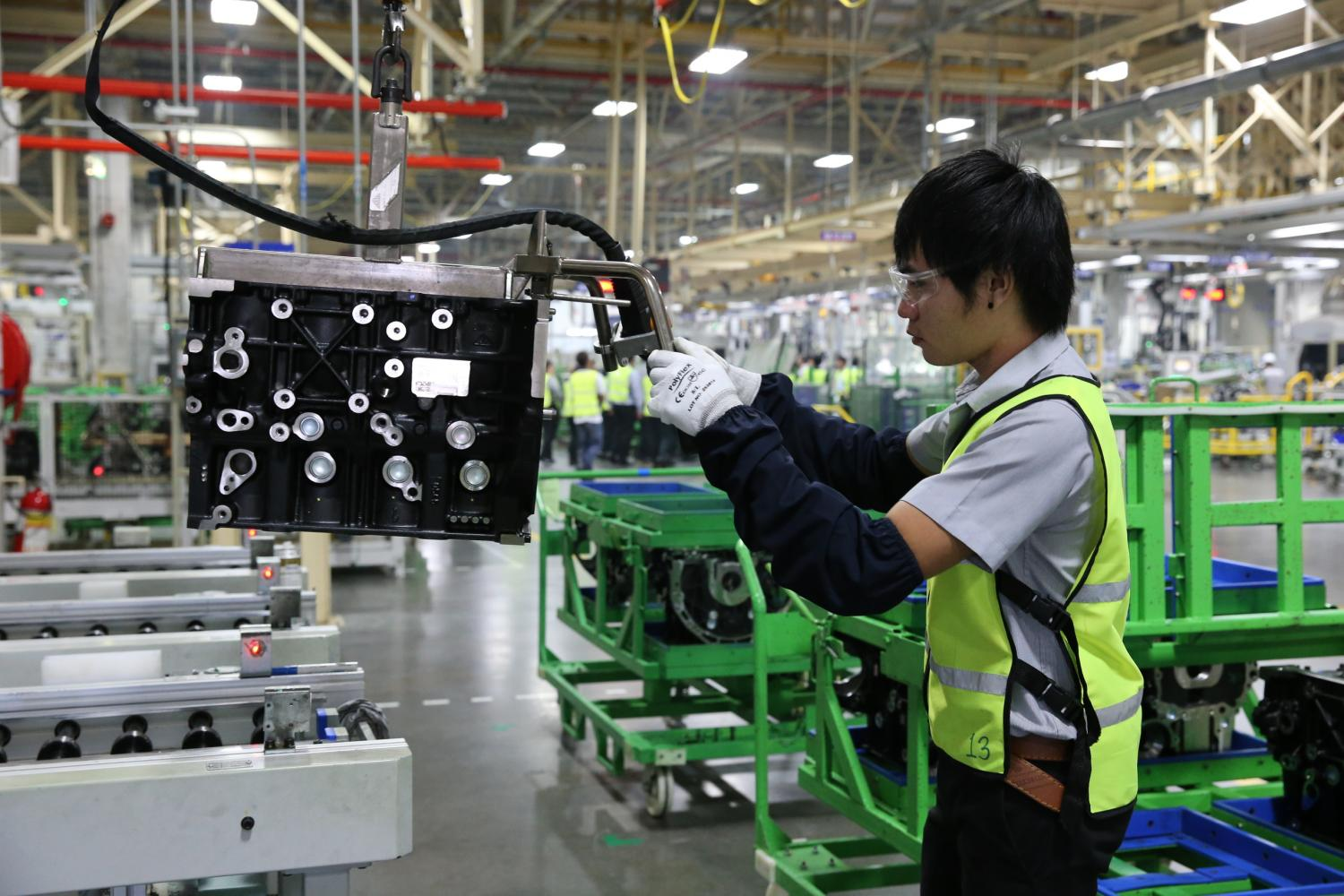 A worker at GM's production line in Rayong. The US car maker will lay off 1,500 employees with severance pay.