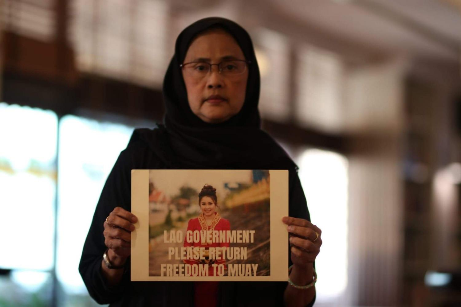 Thailand's former human rights commissioner Angkhana Neelapaijit holds a placard showing the #FreeMuay campaign to raise awareness about the imprisonment of Lao activist Houayheuang 'Muay' Xayabouly. (Photo courtesy of Netiwit Chotiphatphaisal)