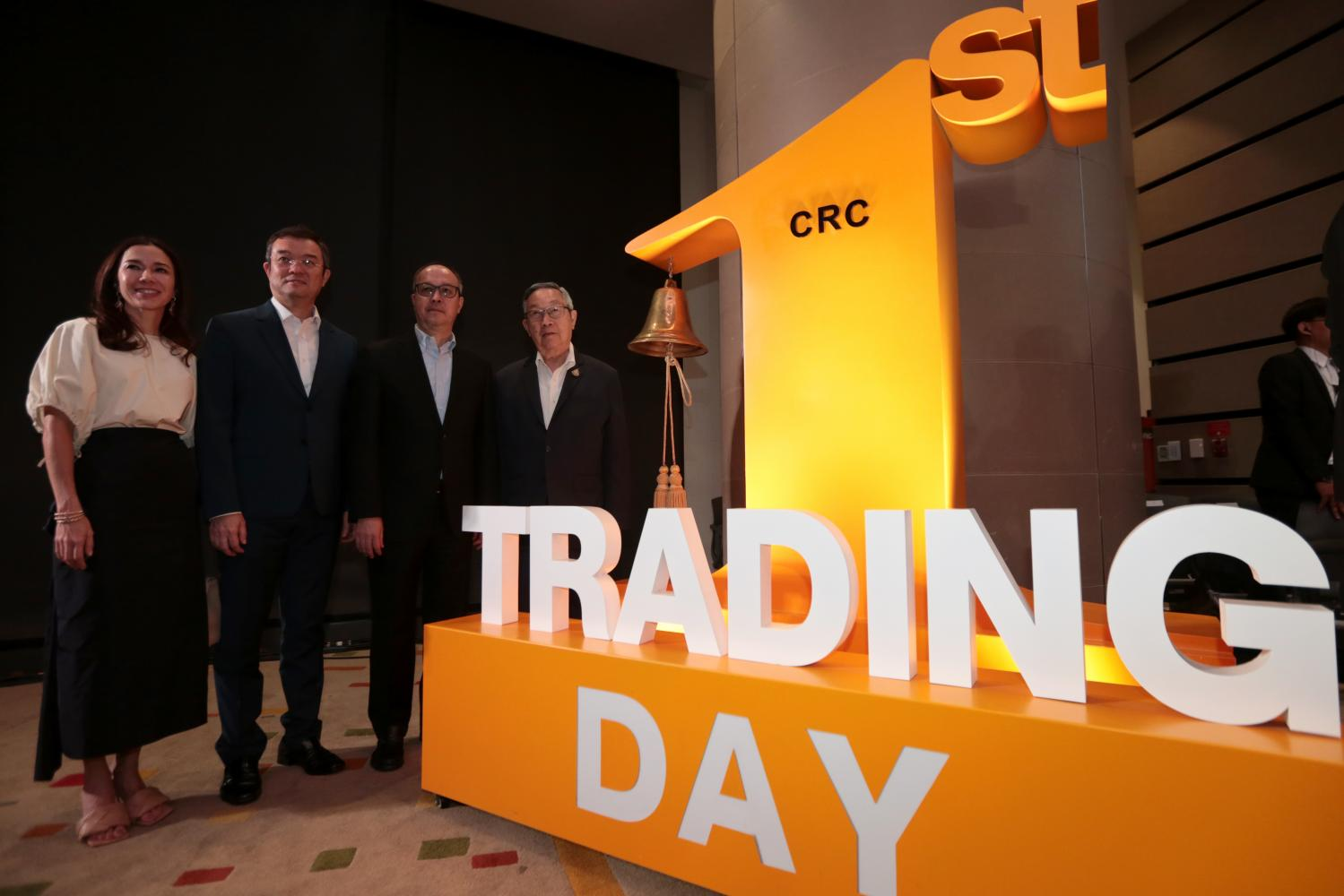 Suthikiati Chirathivat (right), vice-chairman of Central Retail Corporation, celebrates the first day of trade for Central Retail Corporation Plc, Thailand's biggest-ever equity IPO by market cap.Chanat Katanyu