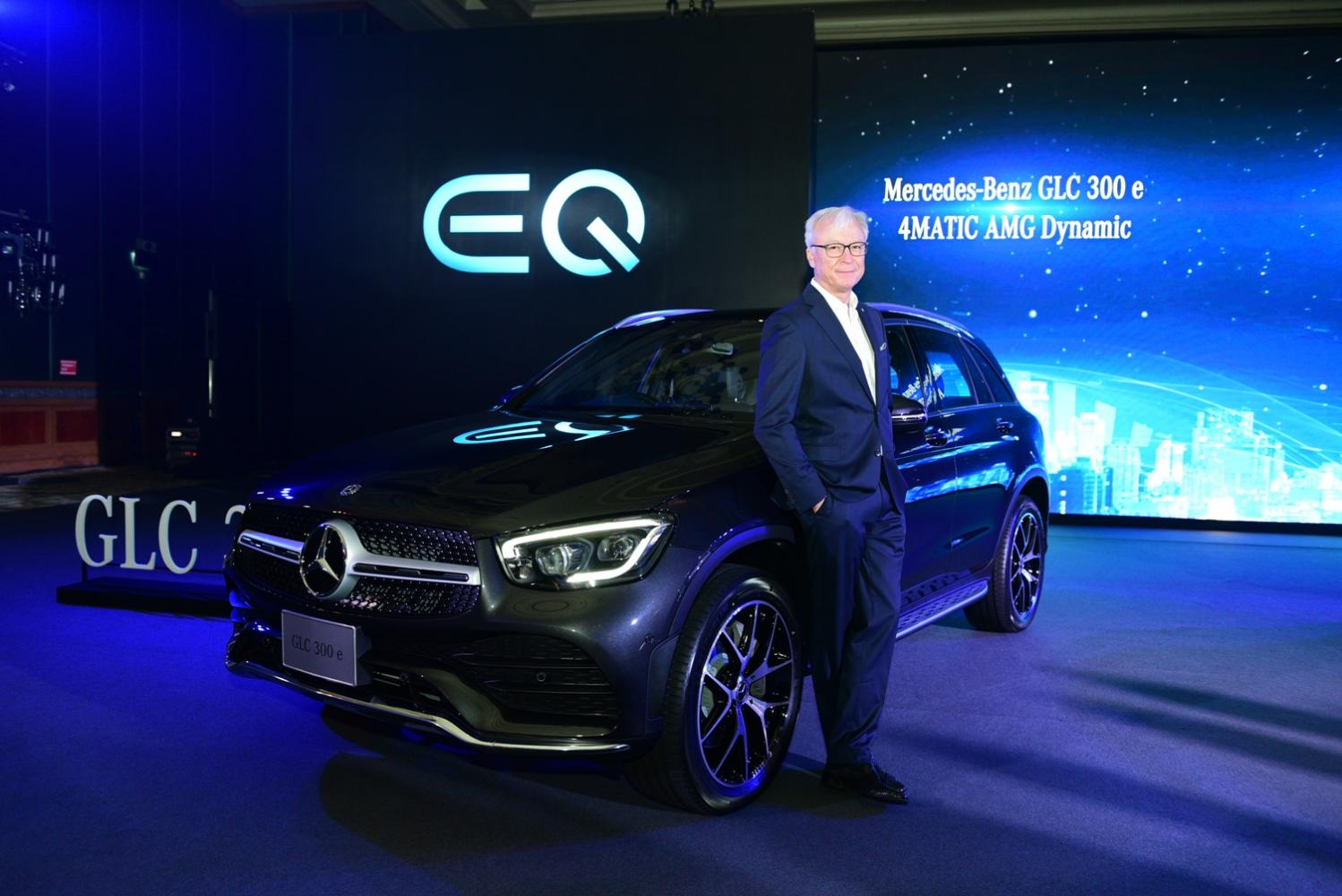 Mr Roland Folger, president and chief executive of Mercedes-Benz Thailand stands with the GLC 300 e 4MATIC AMG Dynamic to be introduced in March.