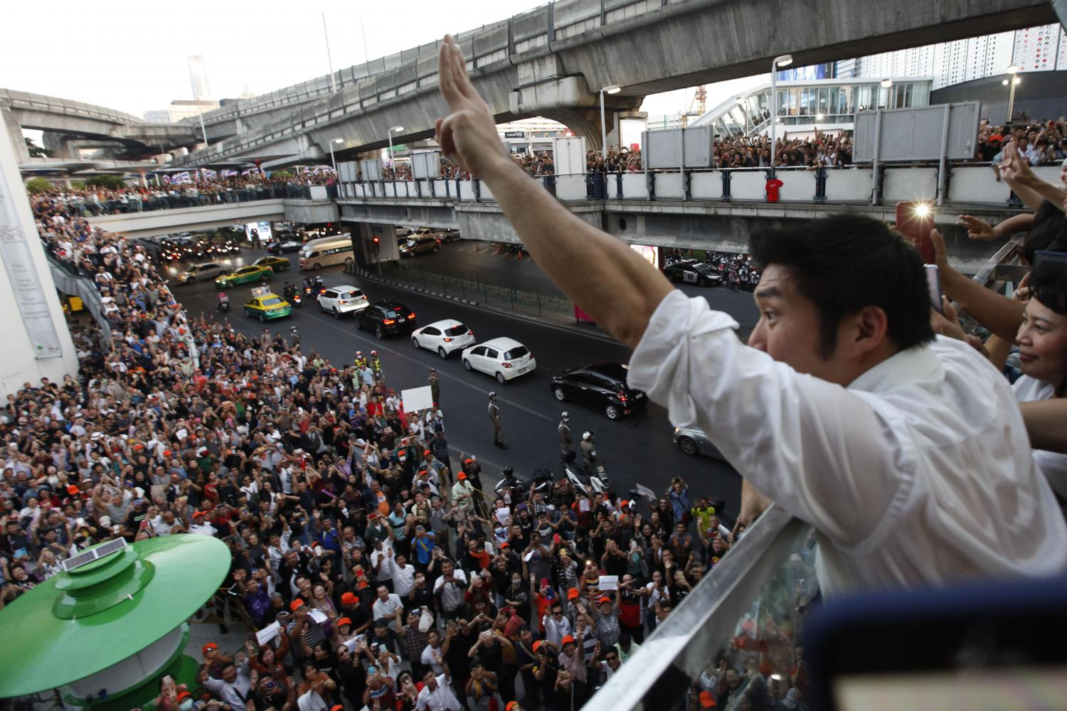 Thanathorn Juangroongruangkit, leader of the Future Forward Party, flashes an anti-coup gesture as he greets his supporters during a gathering last December in Pathumwan district of the capital.Bangkok Post