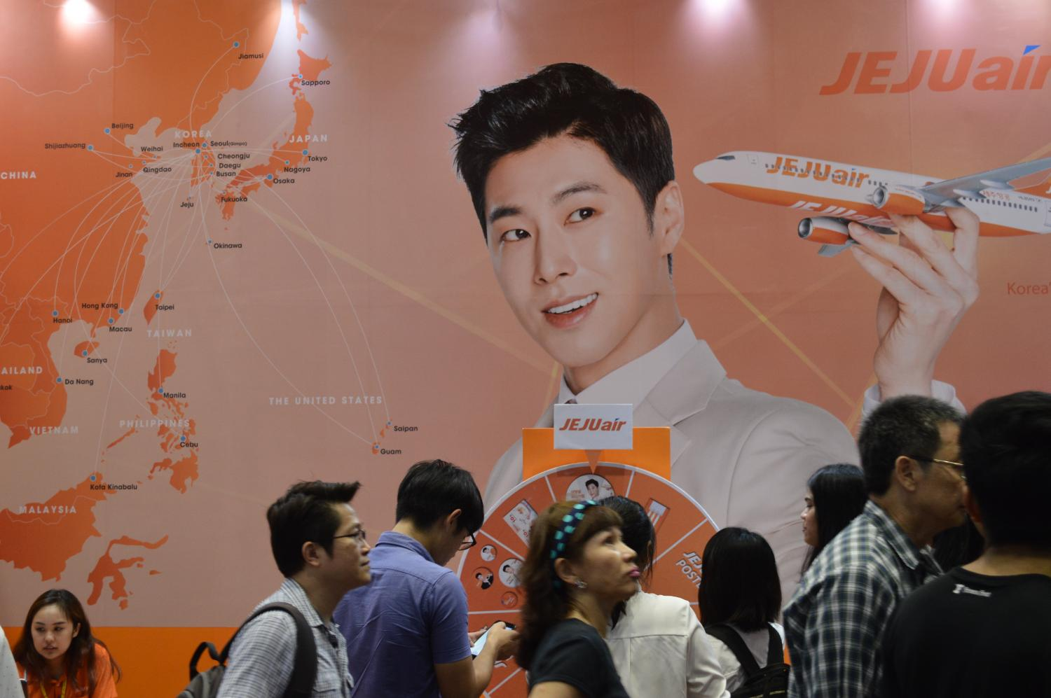An ad for Jeju Air. Amid the coronavirus outbreak, operators are offering cheap tour packages to high-risk countries like South Korea. Worrapon Phayakum