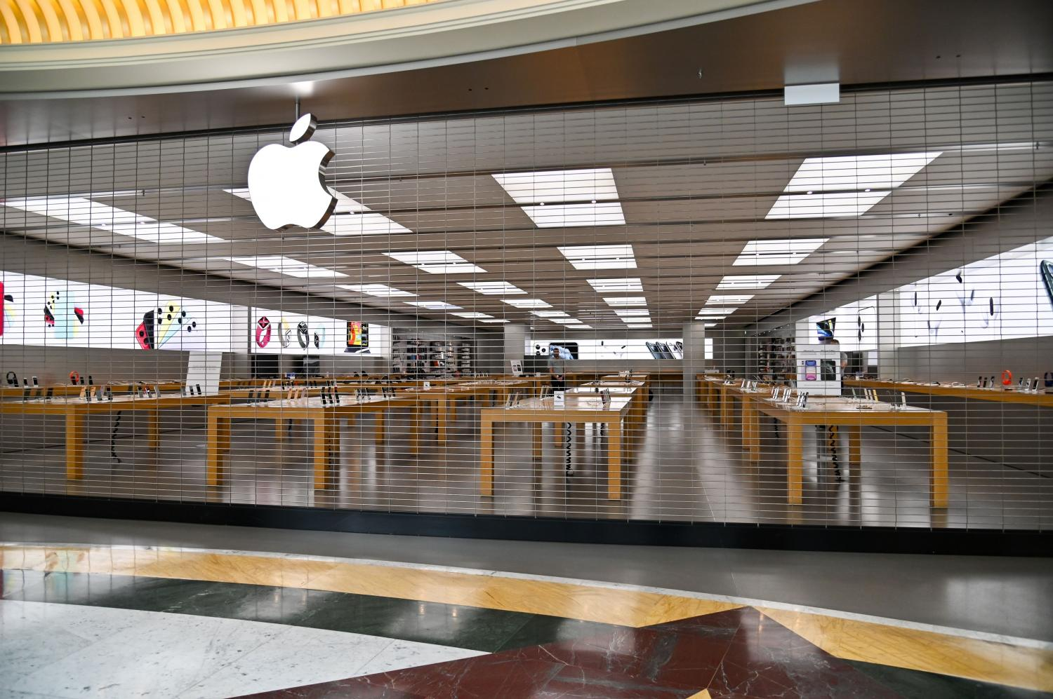 A closed Apple Store is pictured in a deserted shopping mall in Rome. AFP