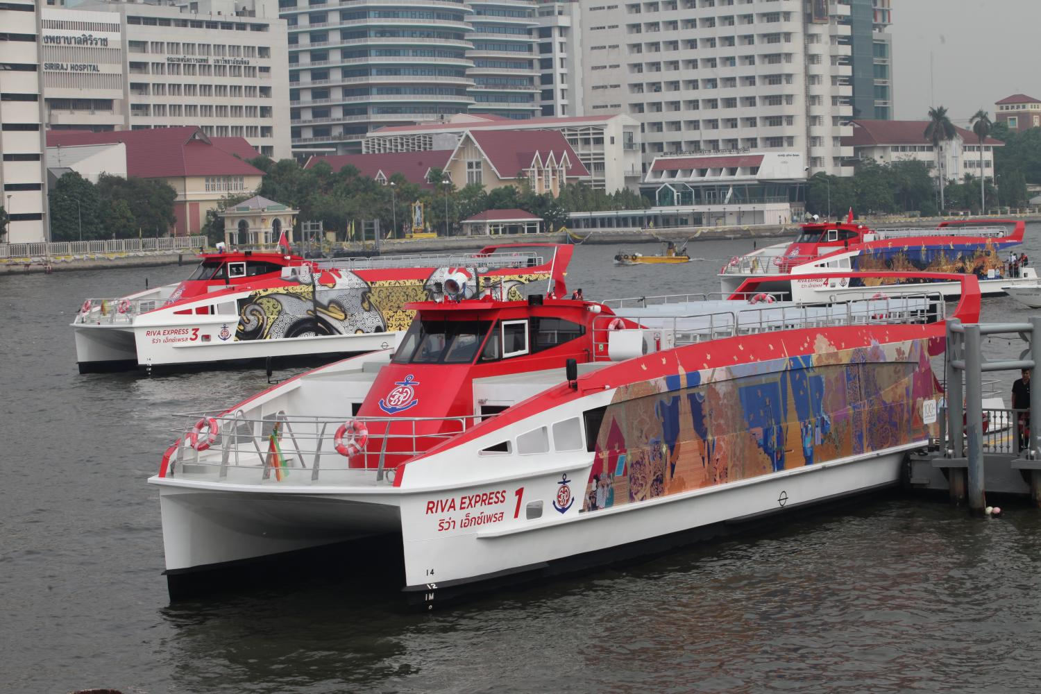 The air-conditioned 'Riva Express' boats are readied for today's official launch. (Photo by Apichart Jinakul)