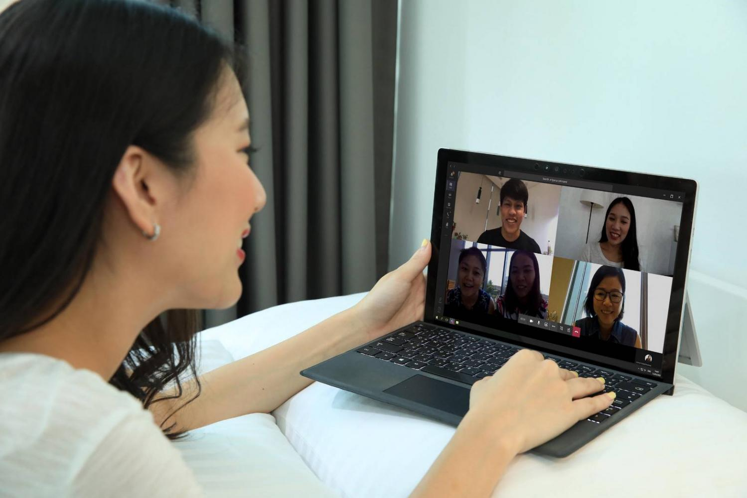 A woman video conferences while working from home. The NBTC says quality internet connections are essential as more people start to work remotely.